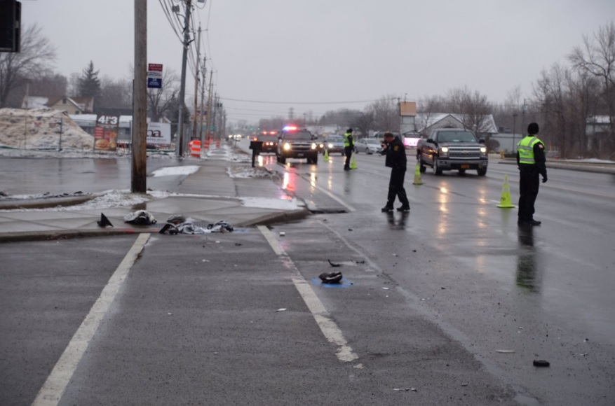 Debris remained at the corner of Niagara Falls Boulevard and Thistle Avenue in the Town of Tonawanda after a pedestrian was struck by a vehicle on Wednesday morning. (John Hickey/Buffalo News)