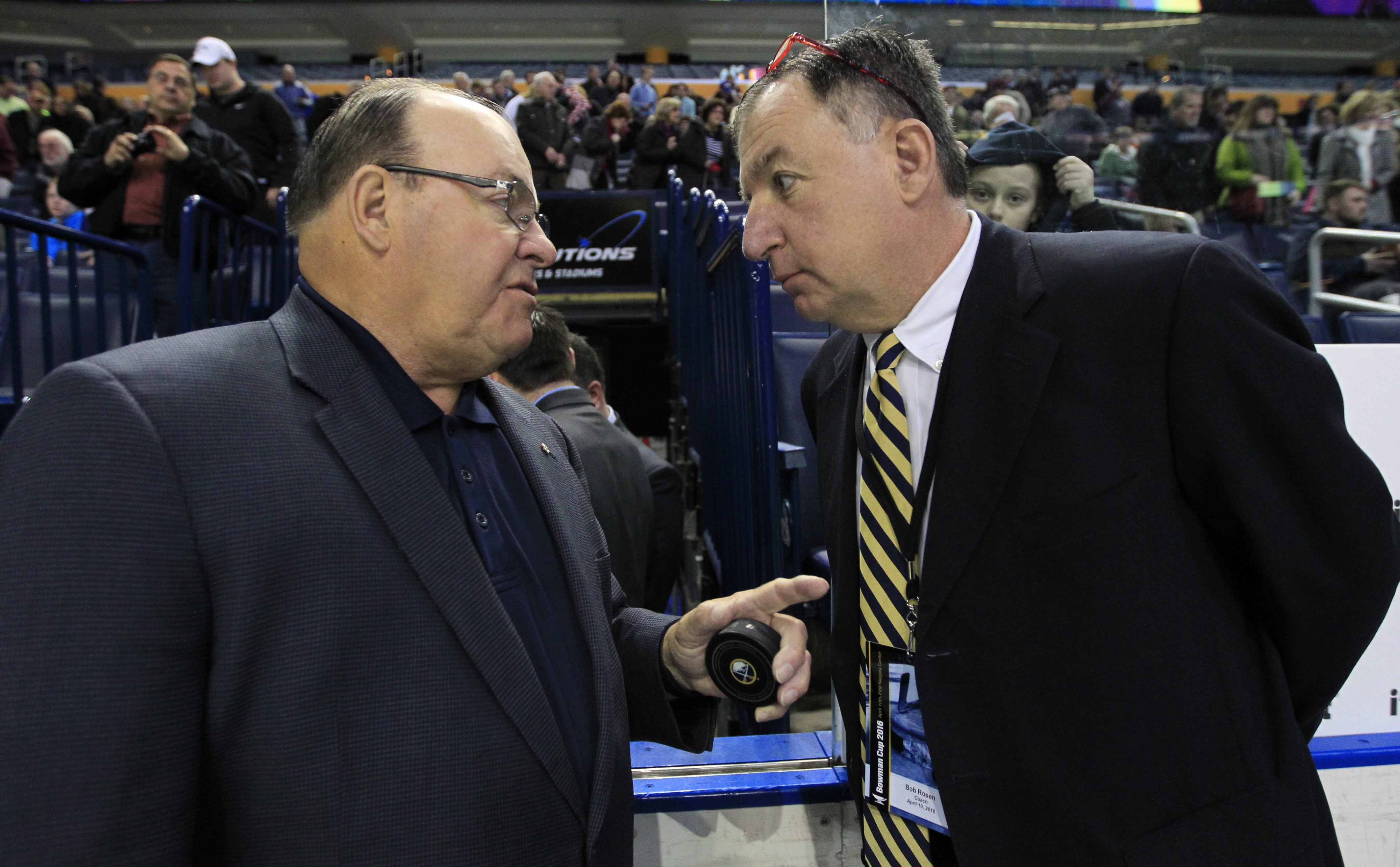 Williamsville North coach Bob Rosen, shown here speaking with NHL Hall of Fame coach Scotty Bowman, left, last April, has guided the Spartans to four state championships. North is making its ninth state final four appearance in 17 years Saturday when it faces defending champion Mamaroneck. (Harry Scull Jr./Buffalo News file photo)