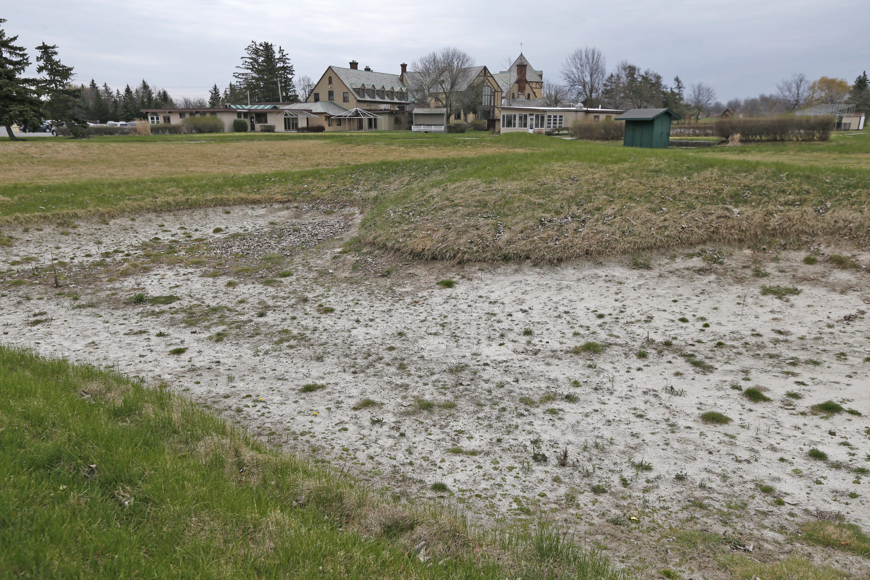 A long-forgotten sand trap on one of the holes  on the grounds at the old Westwood Country Club in Amherst on Thursday, April 21, 2016. Nearby residents have been opposed to a plan to develop the land of the former country club and golf course.  (Robert Kirkham/Buffalo News)