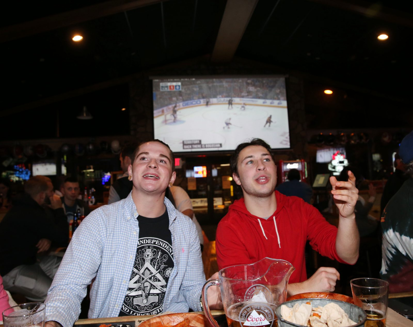 Collin Abbott, left, and Graydon Olson, of Kenmore, catch a Sabres game in the viewer-friendly large bar area at Duff's in Orchard Park. (Sharon Cantillon/Buffalo News)