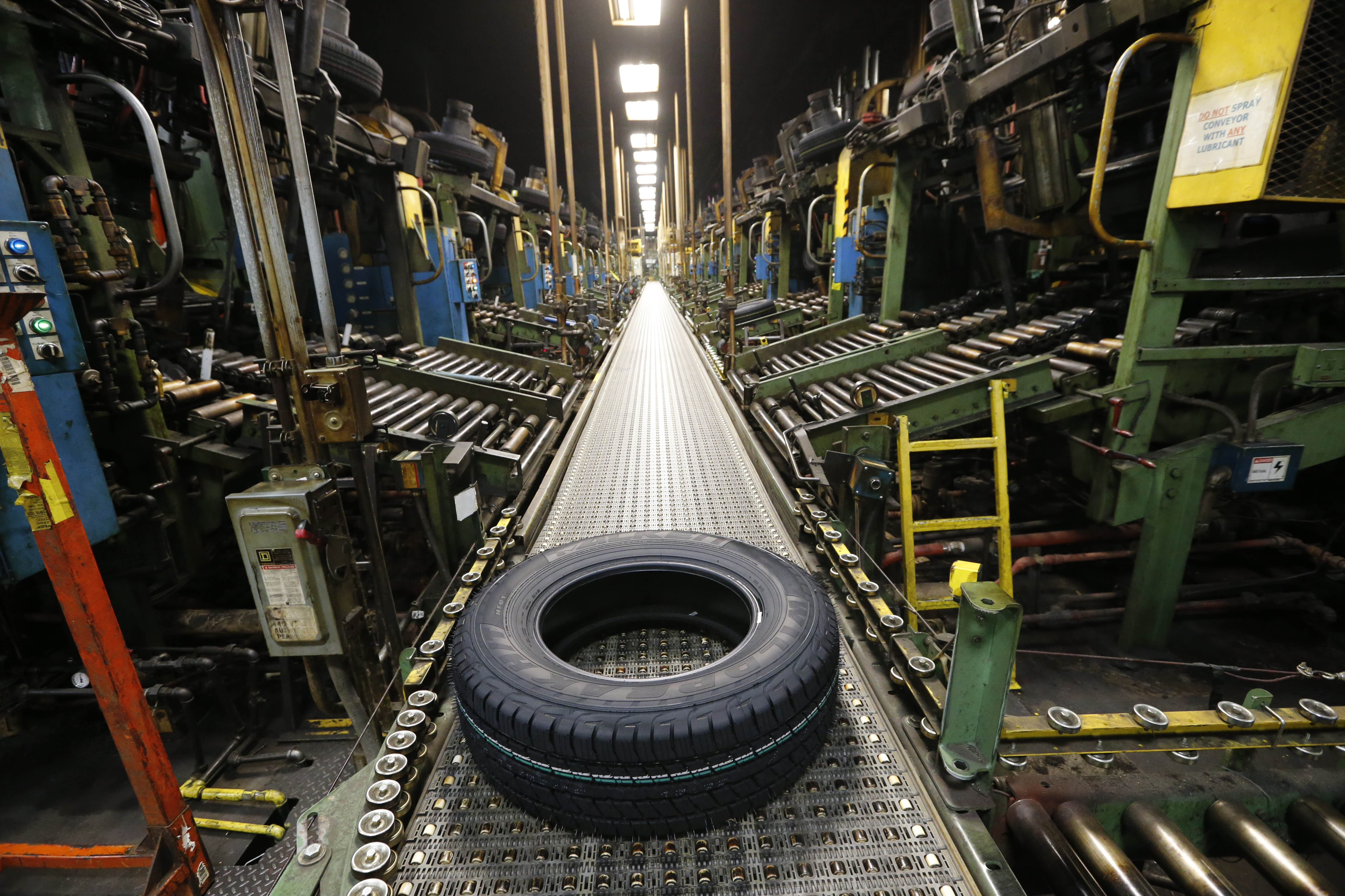A new Falken tire comes off the curing line last November at the Sumitomo Rubber USA tire manufacturing plant in the Town of Tonawanda.  (Derek Gee/Buffalo News file photo)