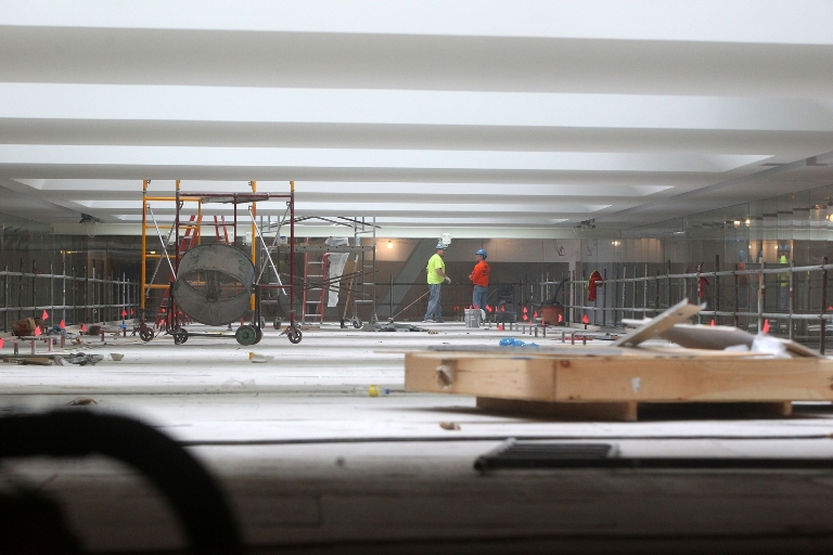 Workers put the finishing touches on the ceiling of the atrium of the new UB Medical School. (Mark Mulville/Buffalo News file photo)