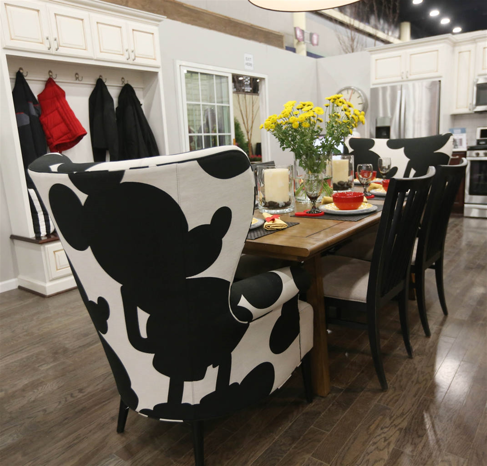 Mickey Mouse chairs at either end of the dining room table in the featured home at : mickey mouse chairs - Cheerinfomania.Com