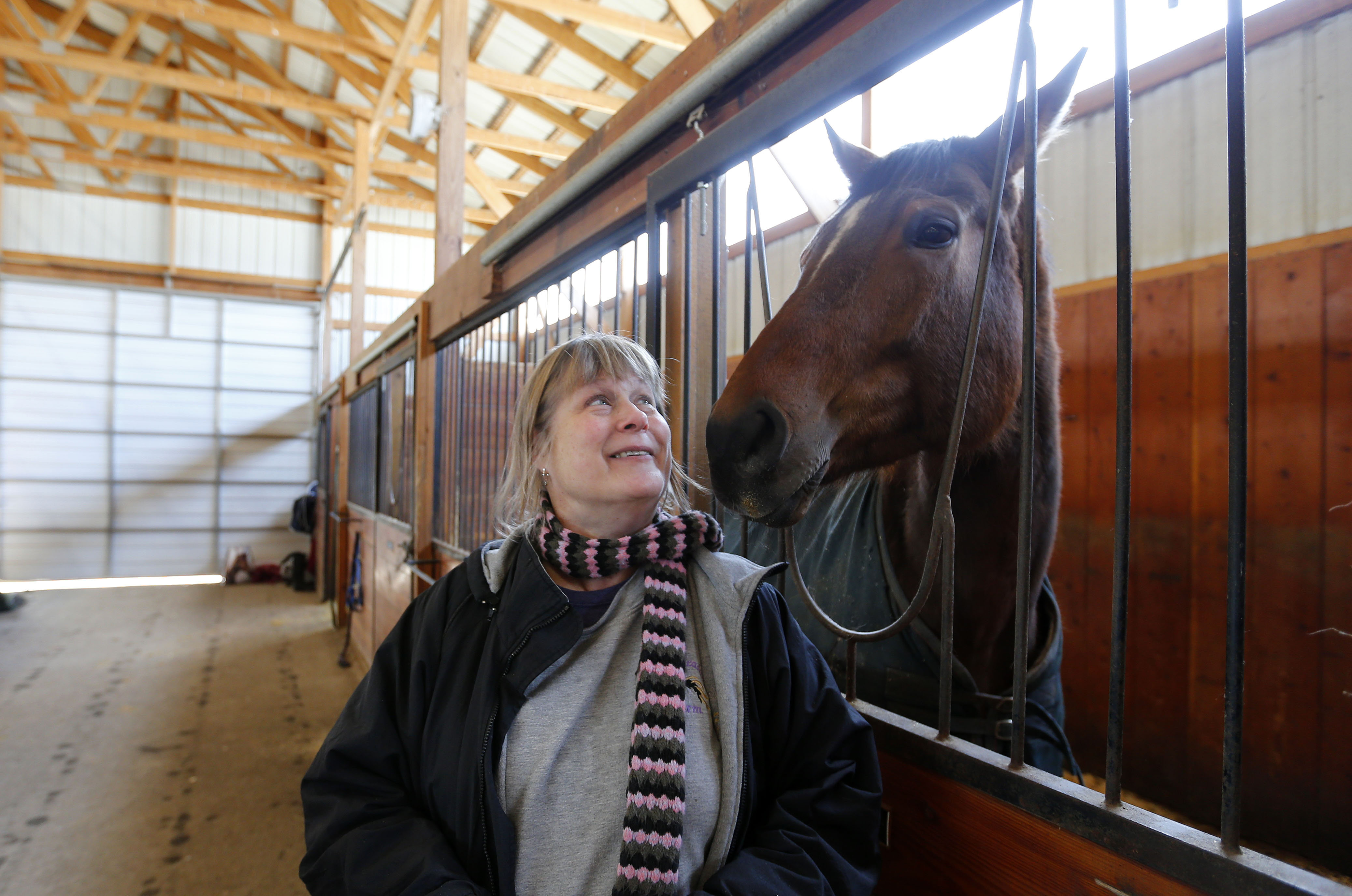 """Owner Karla Deacon has a smile with """"Gemma"""" during Spruce Meadow Farm's 8th annual Winter Horse Show and Soup's On fundraiser to benefit Phoenix Rising Rescue Horses at the stables in Clarence on Sunday, March 5, 2017. (Mark Mulville/Buffalo News)"""