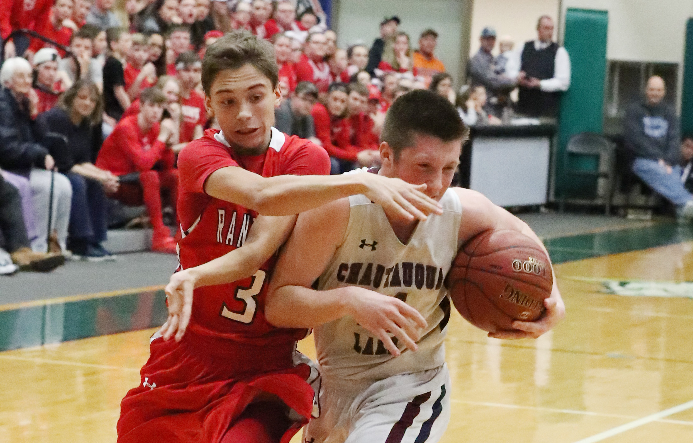 Randolph's Isaac Wakefield battles Chautauqua Lake's Tyler Meredith for the ball in the overall Class C Championship at Jamestown Community College. (James P. McCoy/Buffalo News)