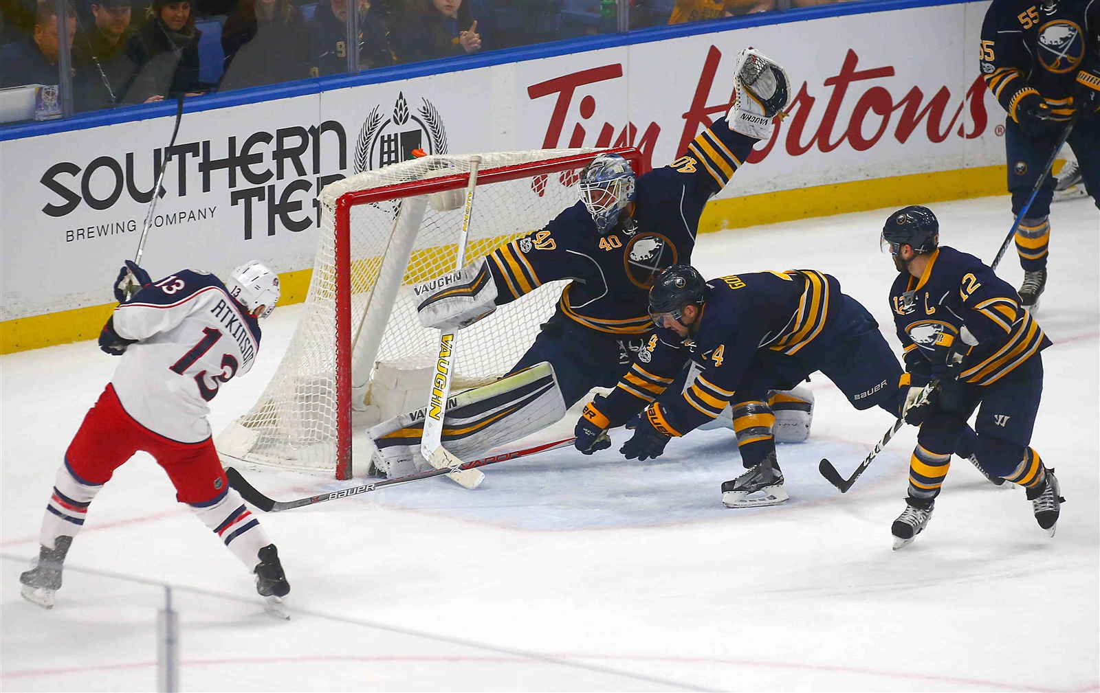 Robin Lehner (40) makes a game-saving save on Cam Atkinson late in the third period in March 2017. (John Hickey/Buffalo News)