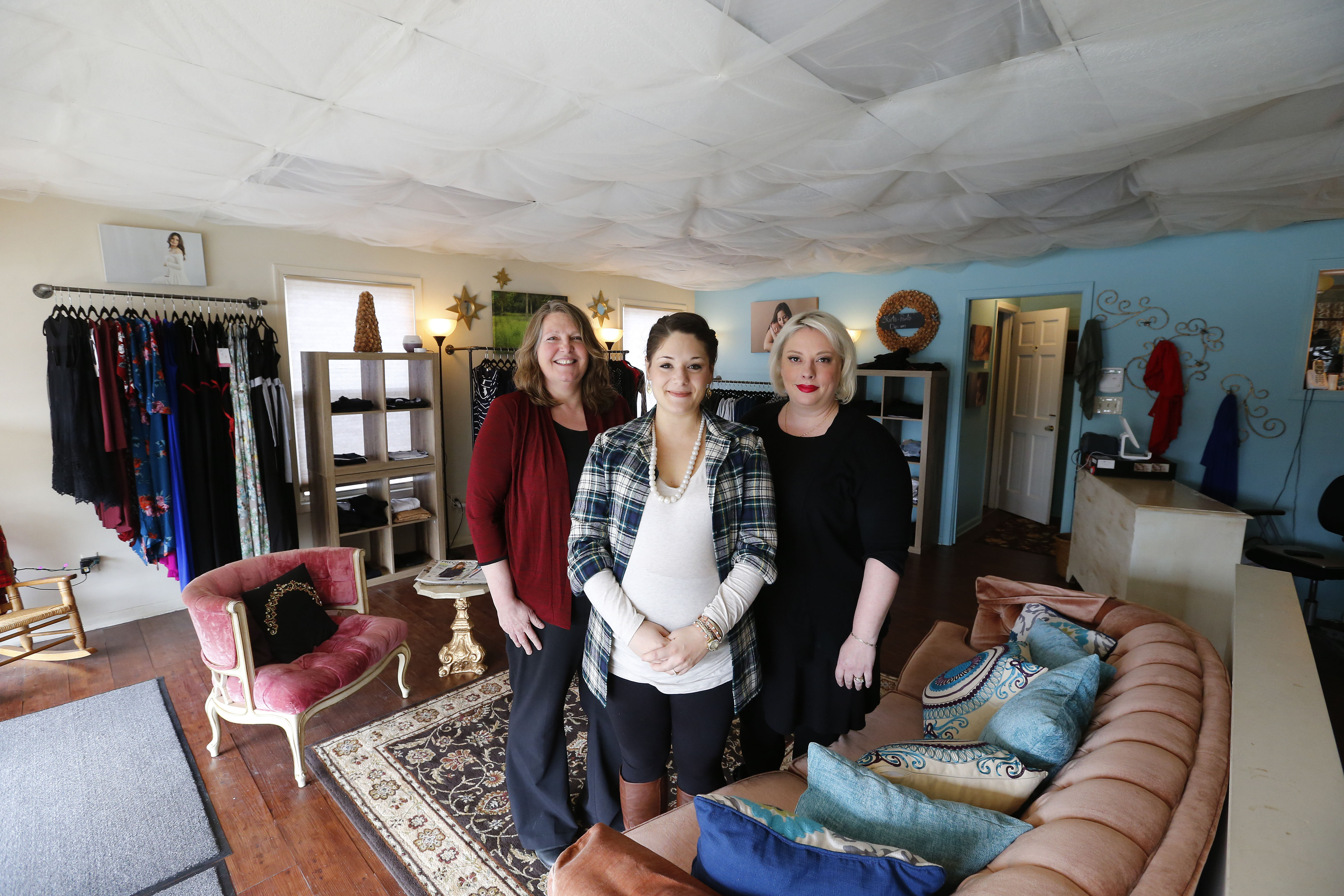 """We're trying to bring moms together and make them aware of their choices. We're also trying to bring the birth community together."" – Elizabeth Carey, left, with Jenny Beam and LouAnn Cane of Western New York Doulas, at Bee Maternal Luxe Maternity in Williamsville (Mark Mulville/Buffalo News)"