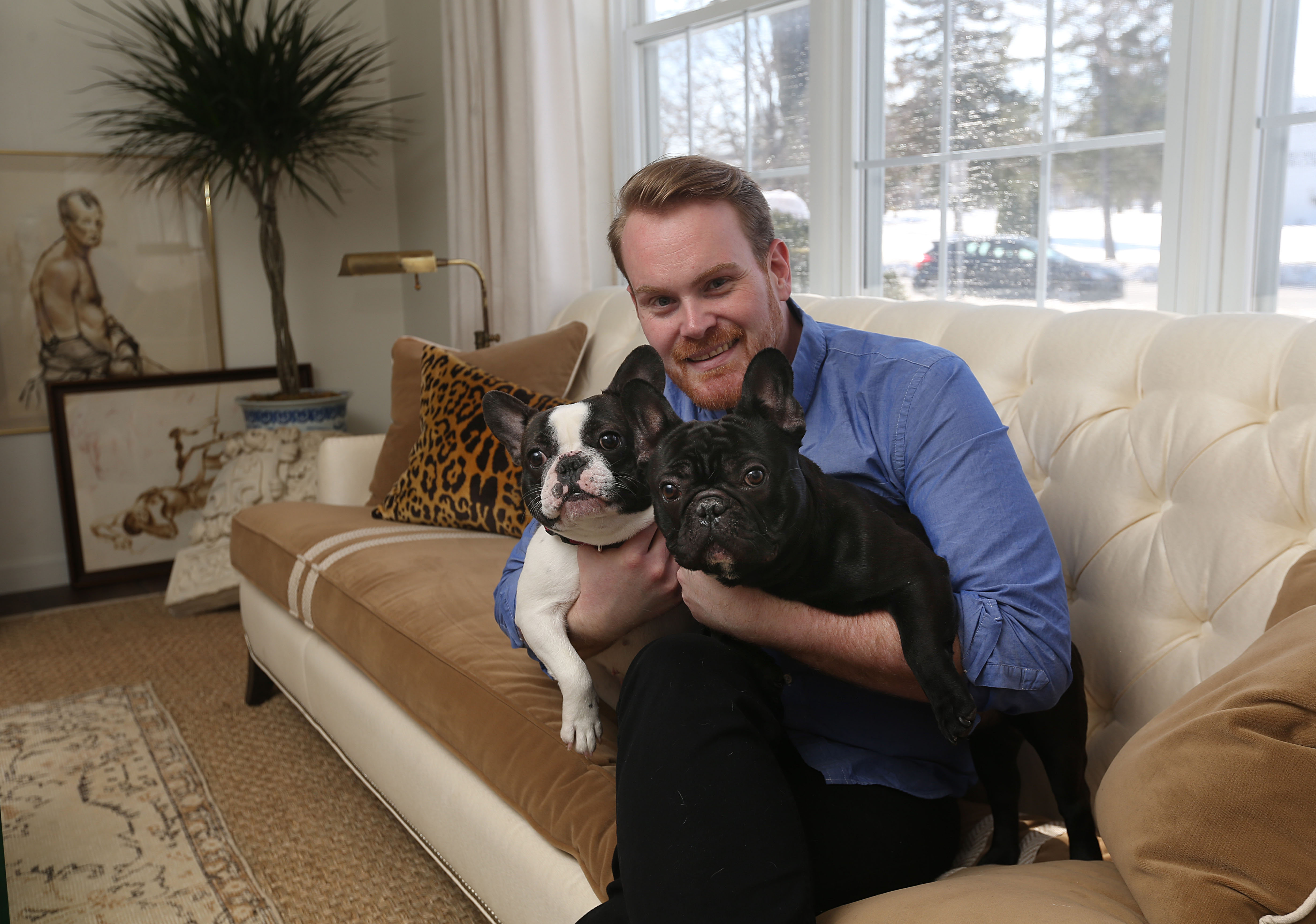 Artie Vanderpool in the living room of his apartment with his dogs - Louna, on the left, and Arlo.  (Sharon Cantillon/Buffalo News)