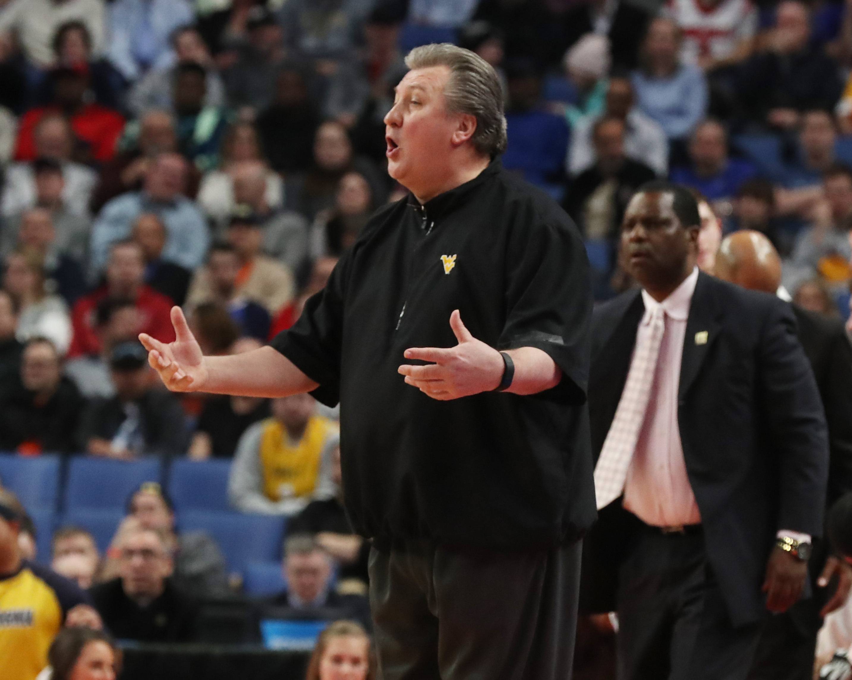 West Virginia Mountaineers Bob Huggins yells to his players in the first half during Thursday's second game of the NCAA Tournament at Key Bank Center.  (James P. McCoy/Buffalo News)