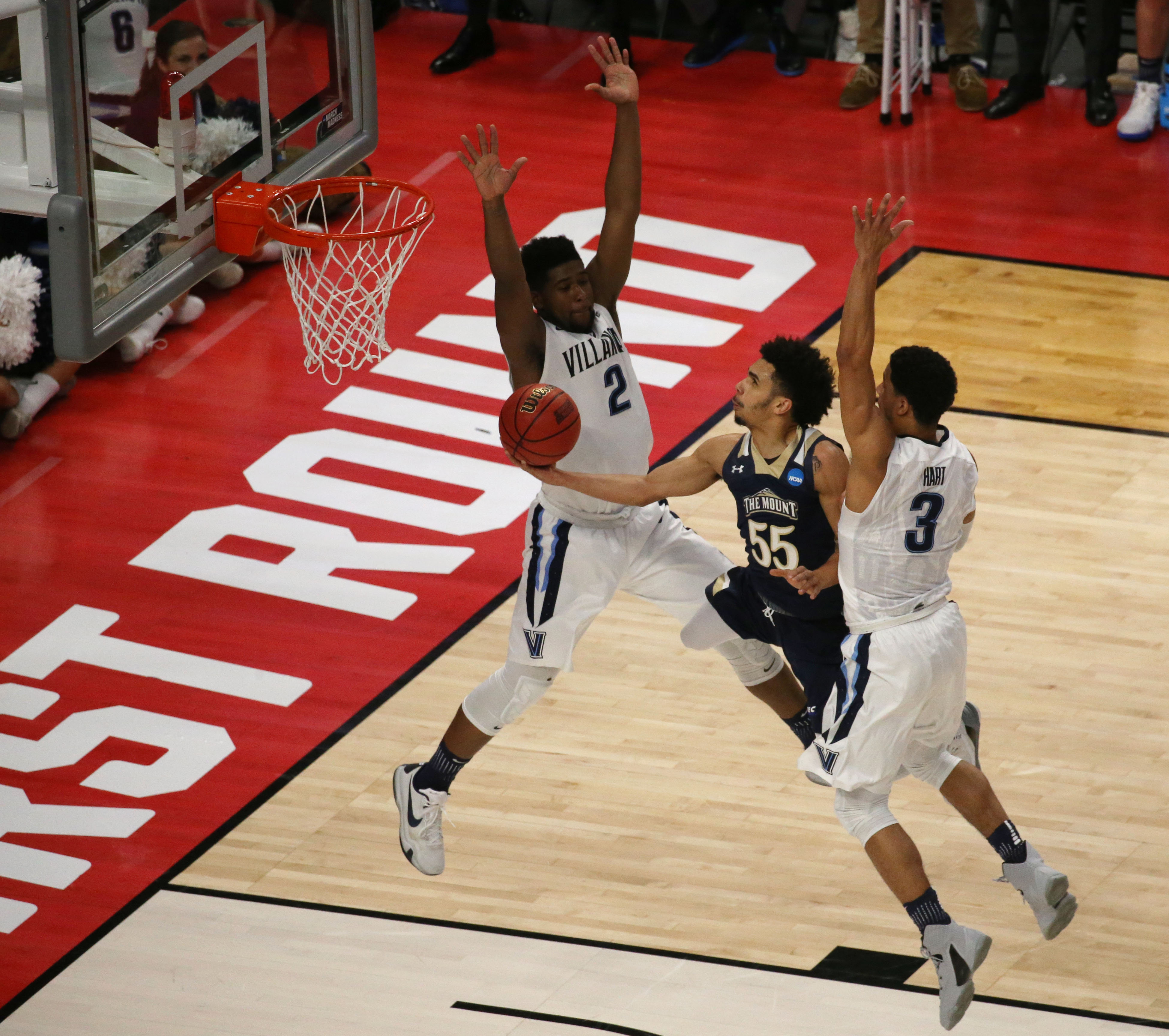 Mount St. Mary's guard Elijah Long (55) drives to the basket against Villanov's Kris Jenkins (2) and Josh Hart (3) during the first half of the NCAA Tournament opening round game at the KeyBank Center, Thursday, March 16, 2017.  (Derek Gee/Buffalo News)