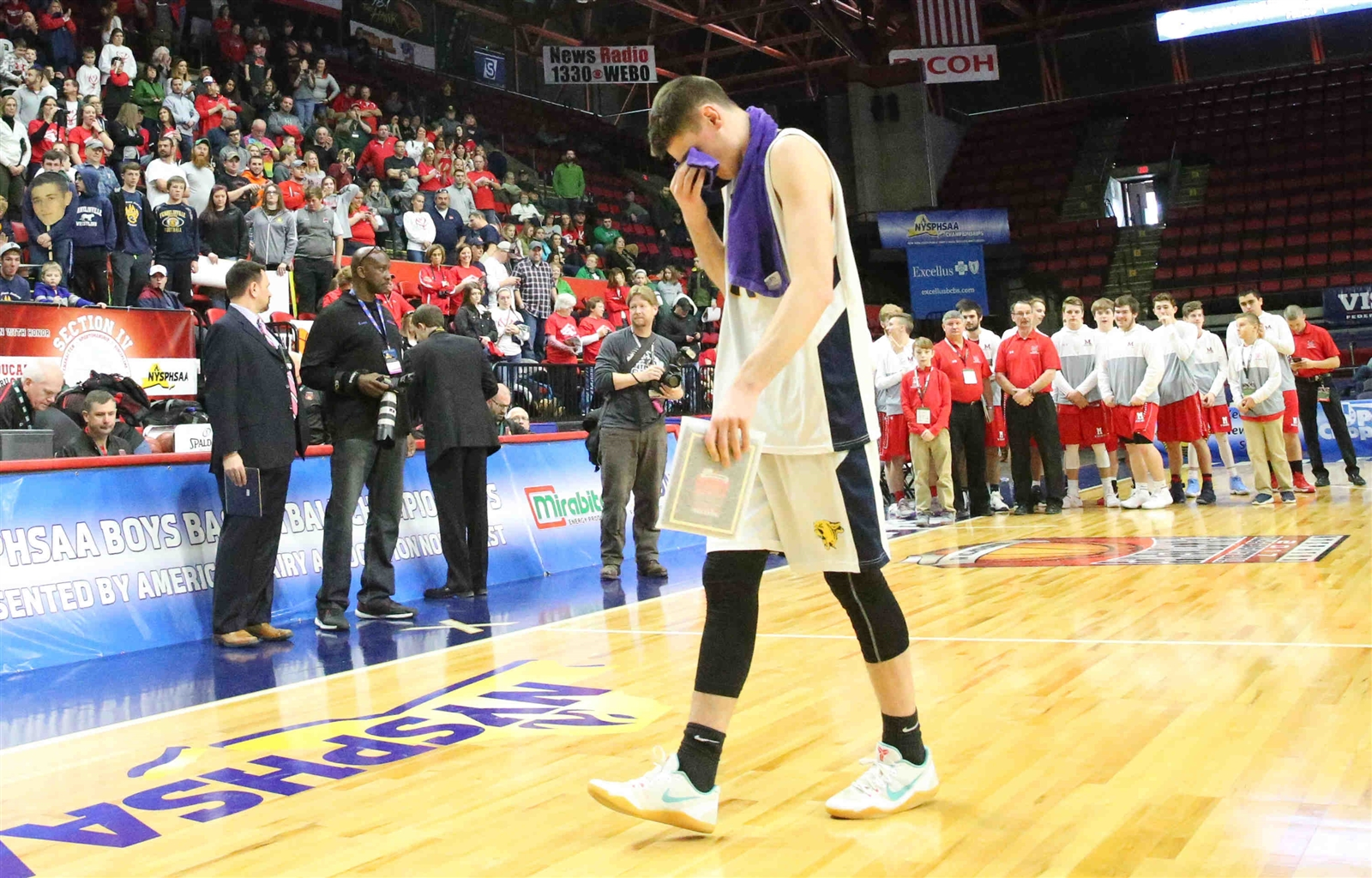 A dejected Sam Erickson walks off the court as Franklinville's dream season ended in the state semifinals to Moriah on Friday at Floyd L. Maines Memorial Arena in Binghamton. (James P. McCoy/Buffalo News)
