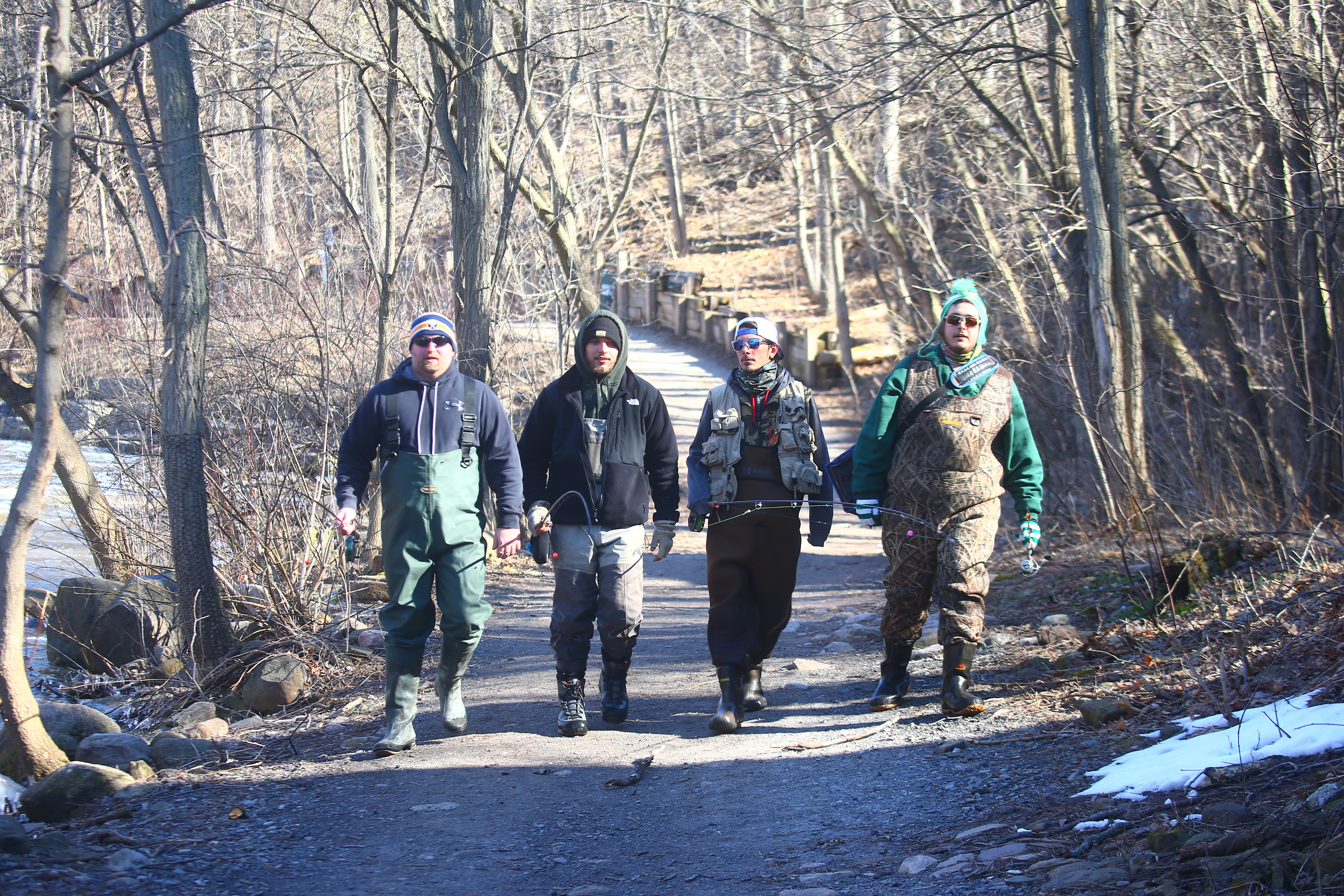 Anglers have formed the backbone of Newfane tourism for generations. On their way to pursue steelheads are, from left, Sean Haas, Matt Wagner, Zak Dolden and R.J. Brant. The four were headed to Burt Dam on Eighteen Mile Creek. (John Hickey/Buffalo News)