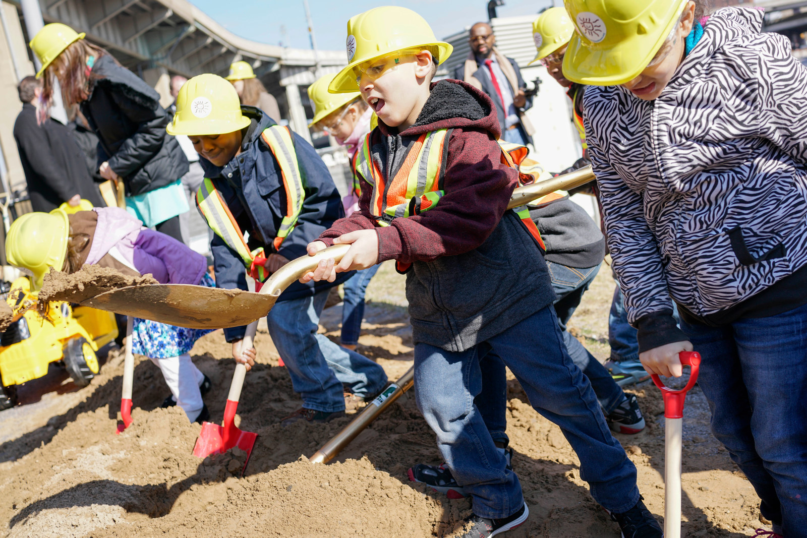 Second grade students from Waterfront Elementary have fun digging in the dirt at the groundbreaking for the new Explore & More Children's Museum at Canalside, Wednesday, March 29, 2017.  (Derek Gee/Buffalo News)