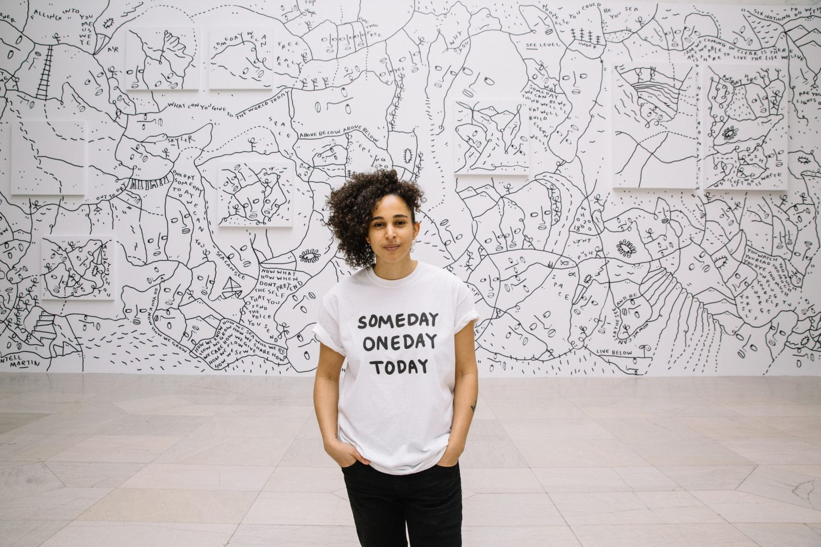 British artist Shantell Martin poses in front of her work at the Albright-Knox Art Gallery's sculpture court. (Photo by Connie Tsang.)