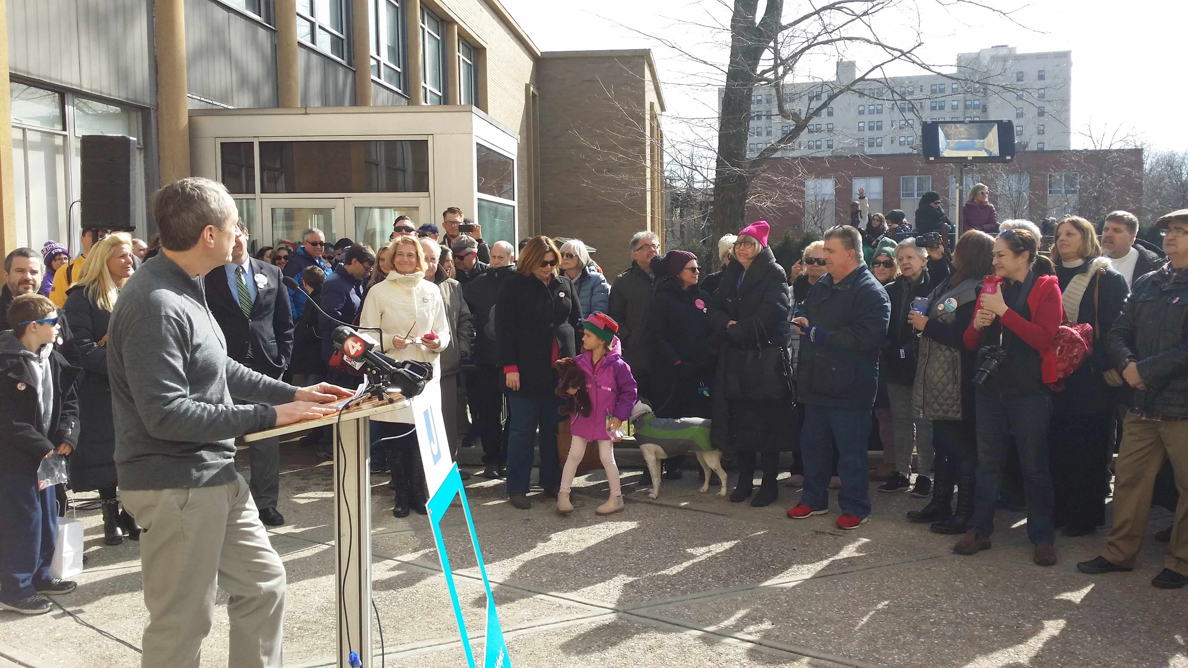 Assemblyman Sean Ryan welcomes the crowd outside the Jewish Community Center.