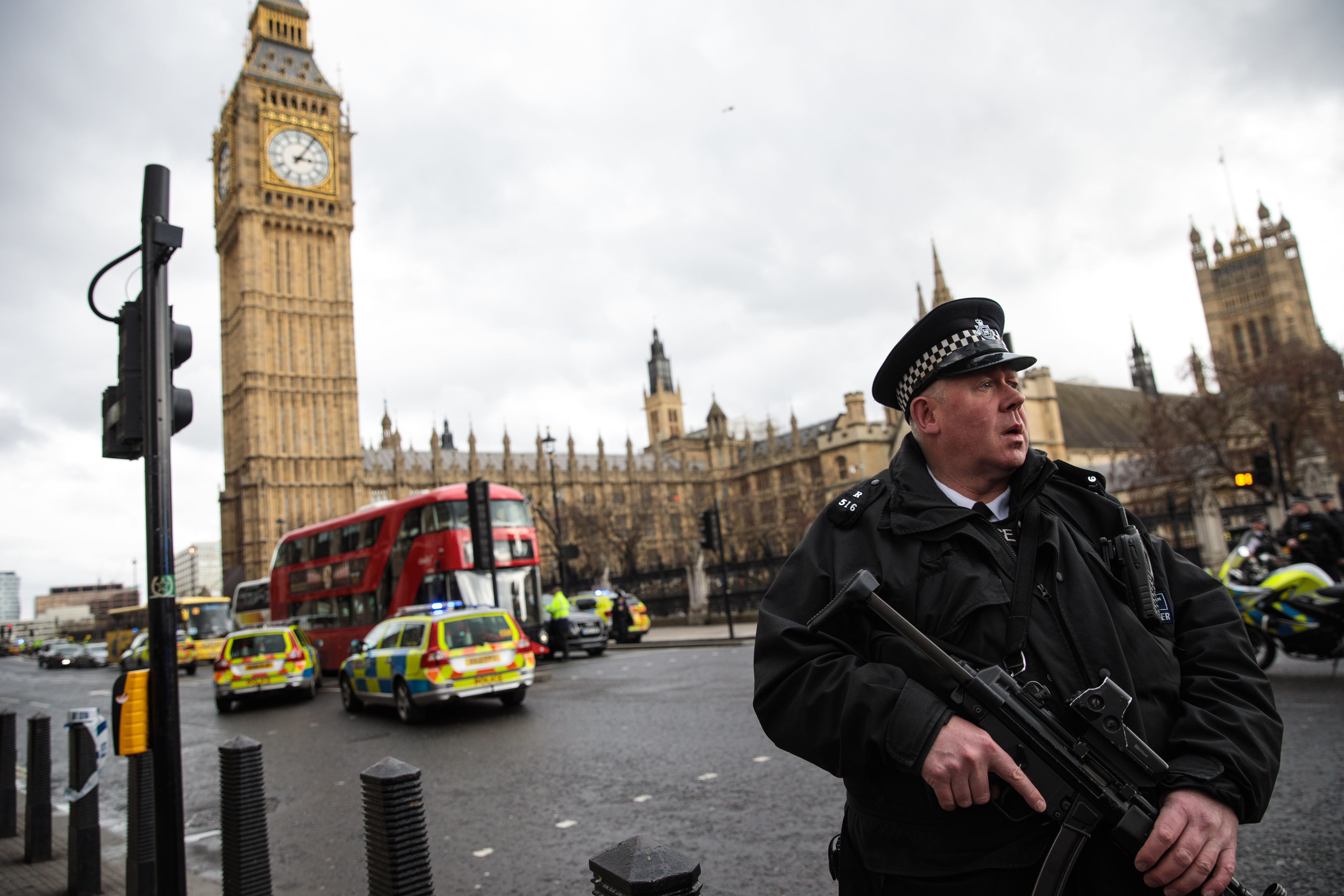 An armed police officer stands guard near Westminster Bridge and the Houses of Parliament on March 22, 2017, in London, after an attack police are treating as a terrorist incident. (Getty Images)