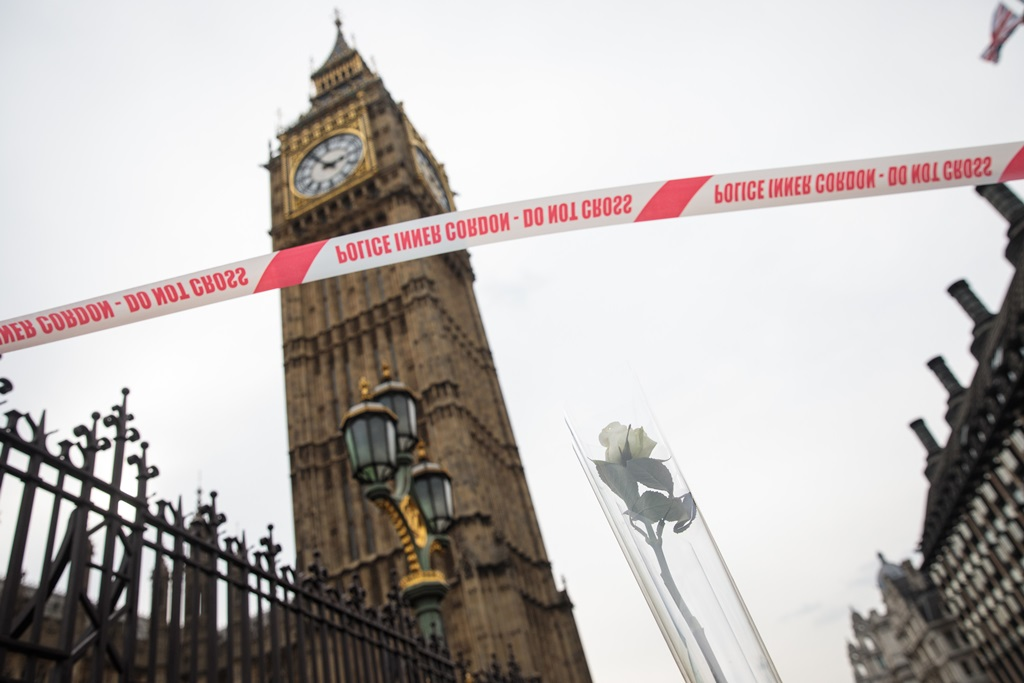 Police tape and a rose placed in a traffic cone are seen with Big Ben in the background on Westminster Bridge following Wednesday's attack in which one police officer was killed. Four people have been killed and around 40 people injured following yesterday's attack by the Houses of Parliament in Westminster. (Photo by Jack Taylor/Getty Images)