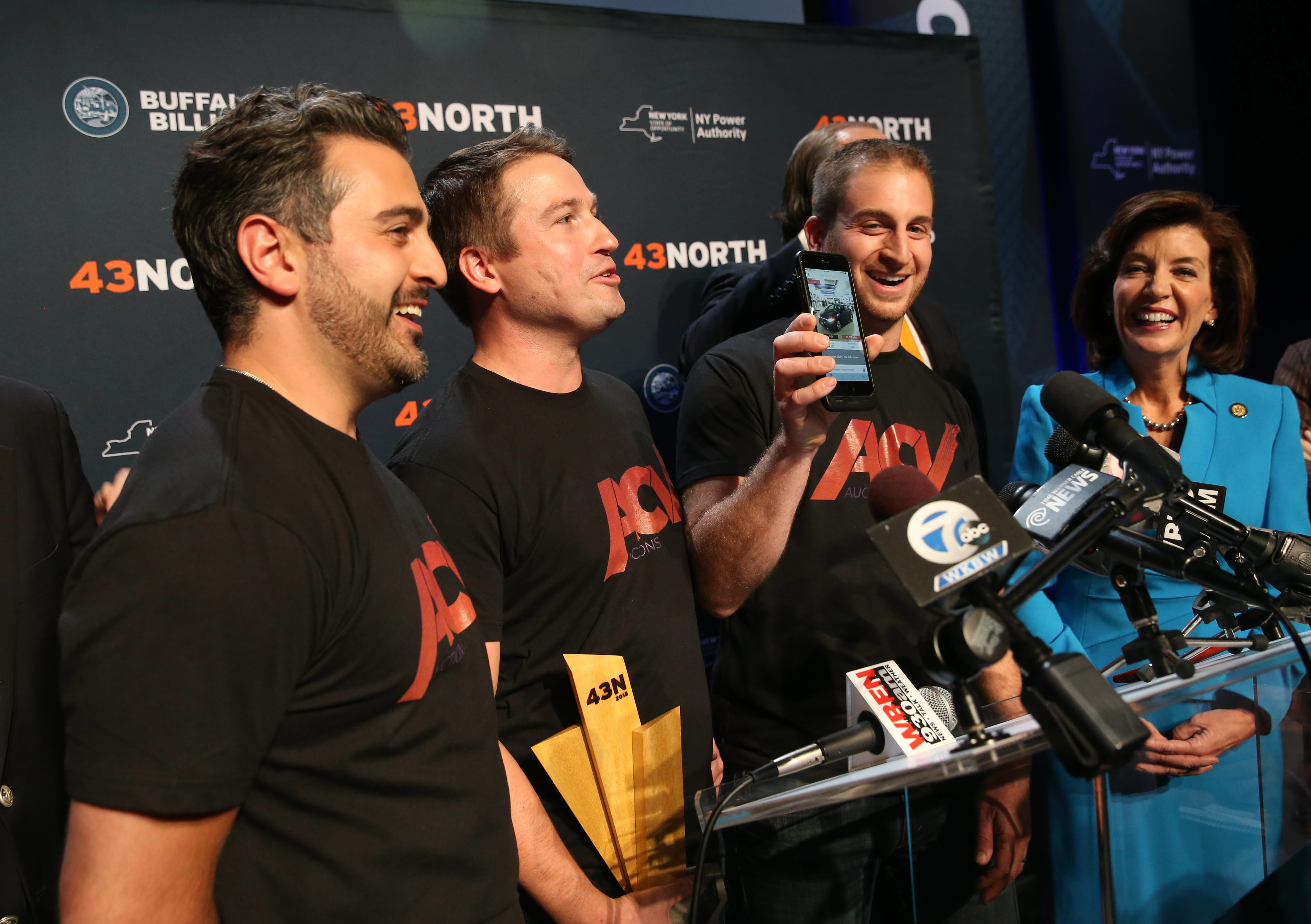 ACV Auctions, which won the $1 million grand prize in the 43North competition in 2015, has secured $15 million in new venture capital funding.  From left are Jack Greco, Dan Magnuszewski and Joe NIeman.    On far right is Lt. Governor Kathy Hochul. (Sharon Cantillon/Buffalo News file photo)