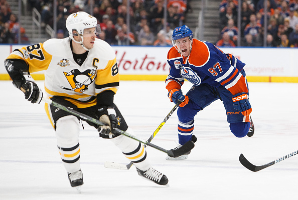 Connor McDavid battled to keep up with Sidney Crosby during the Penguins' shootout win over the Oilers Friday night in Edmonton (Getty Images).