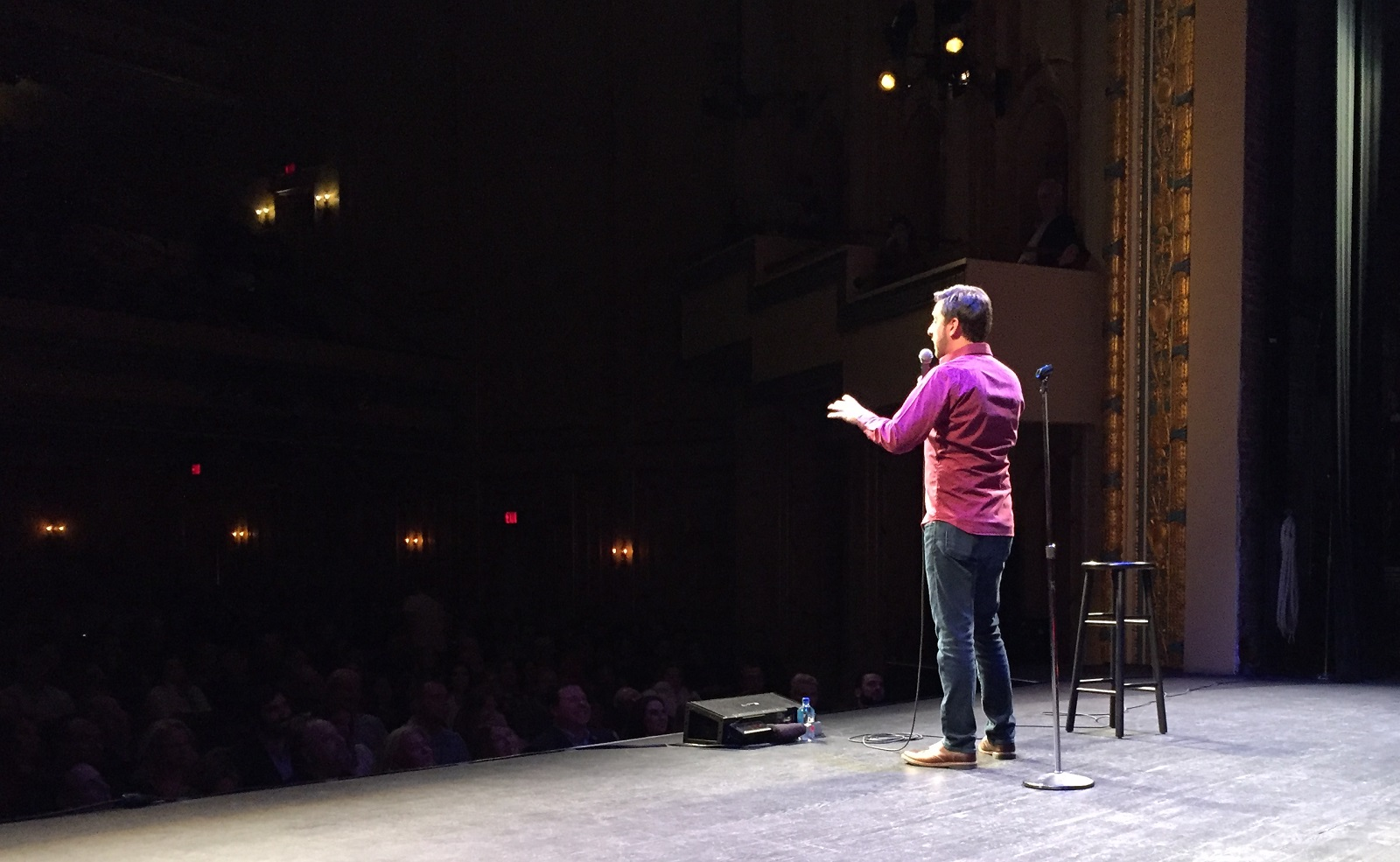 Comedian Brian Herberger performing on stage.