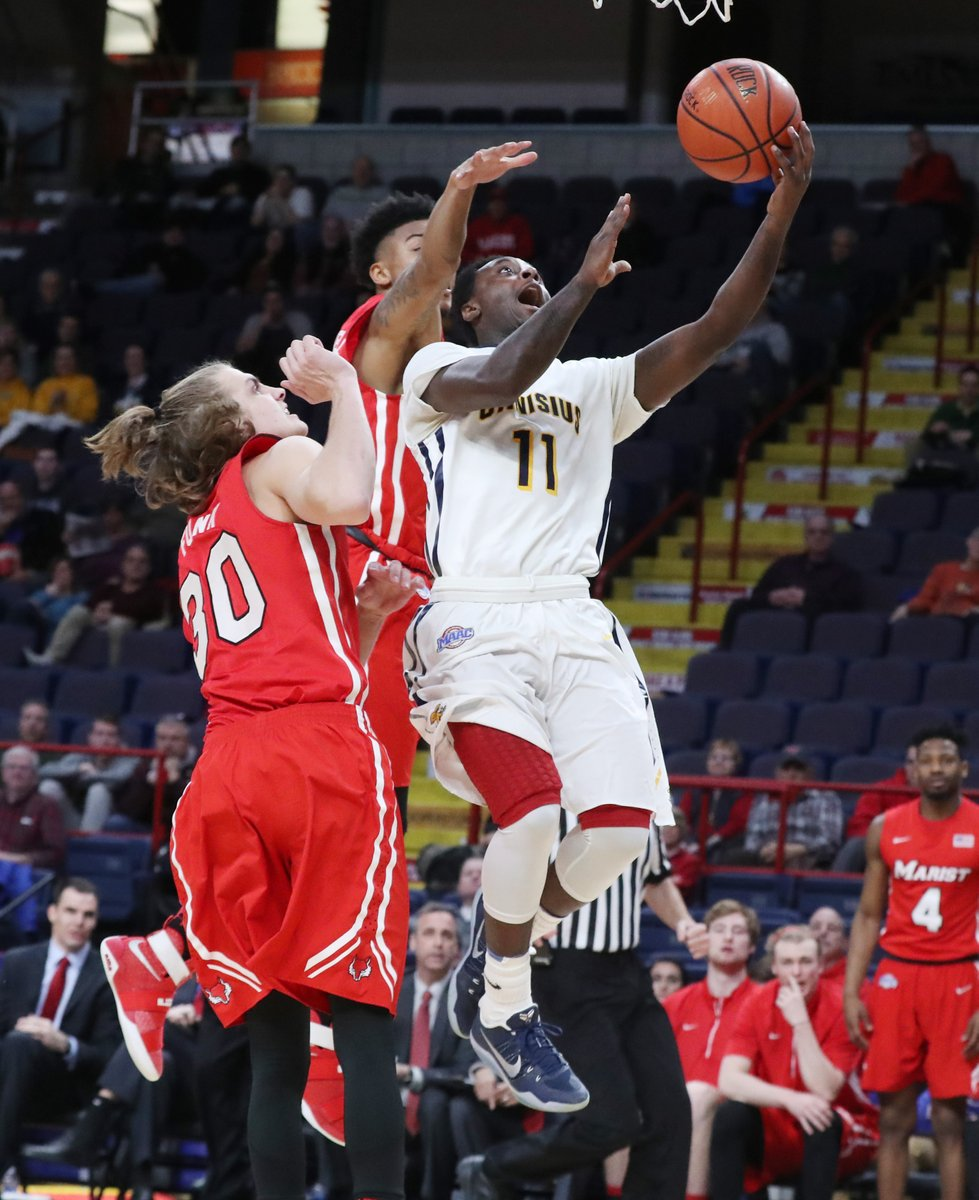Canisius' Chris Atkinson drives on Marist. (James P. McCoy/Buffalo News)