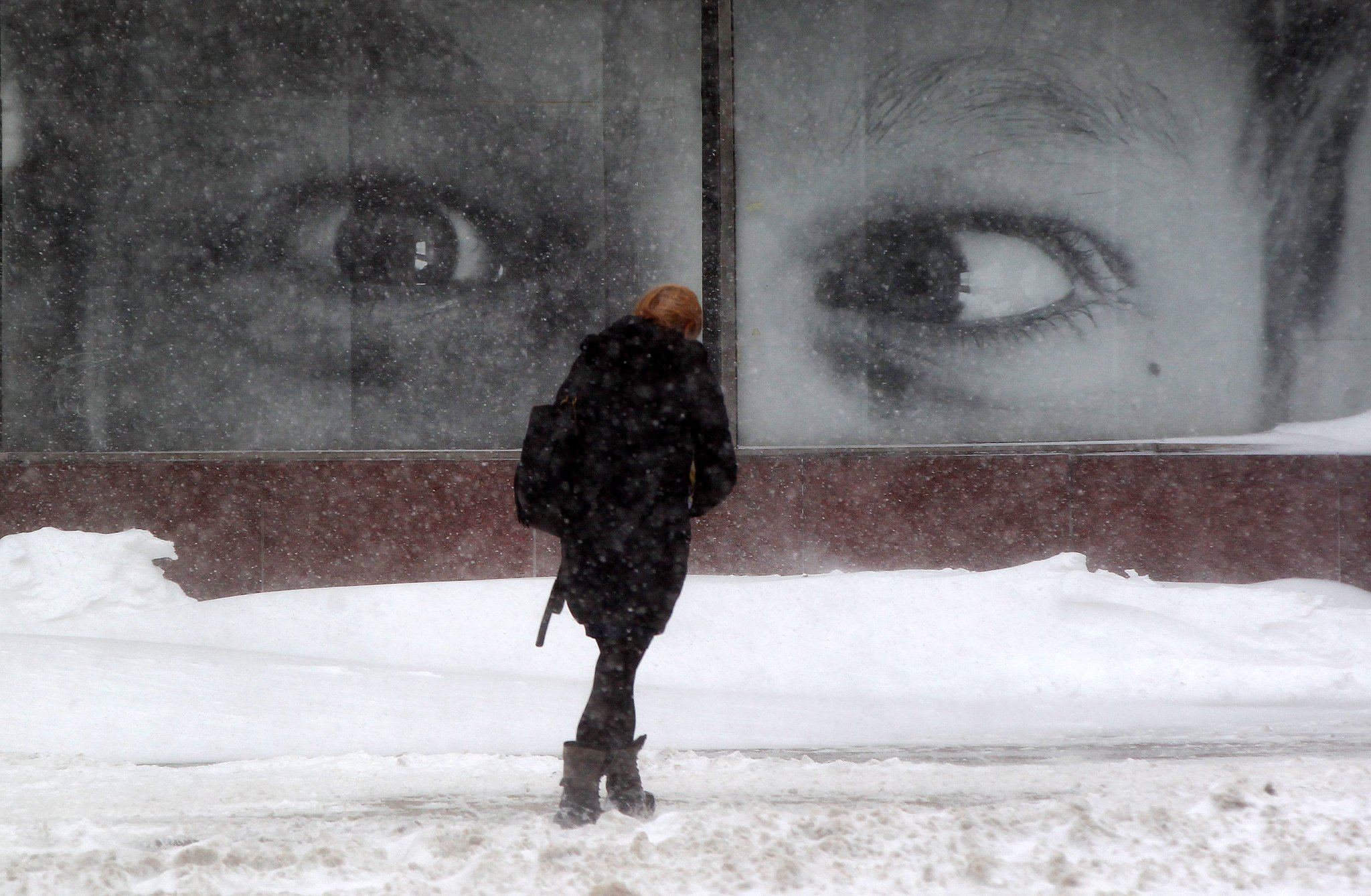A pedestrian makes their way through the snow and the wind on Franklin Street in Buffalo Wednesday. (Mark Mulville/Buffalo News)