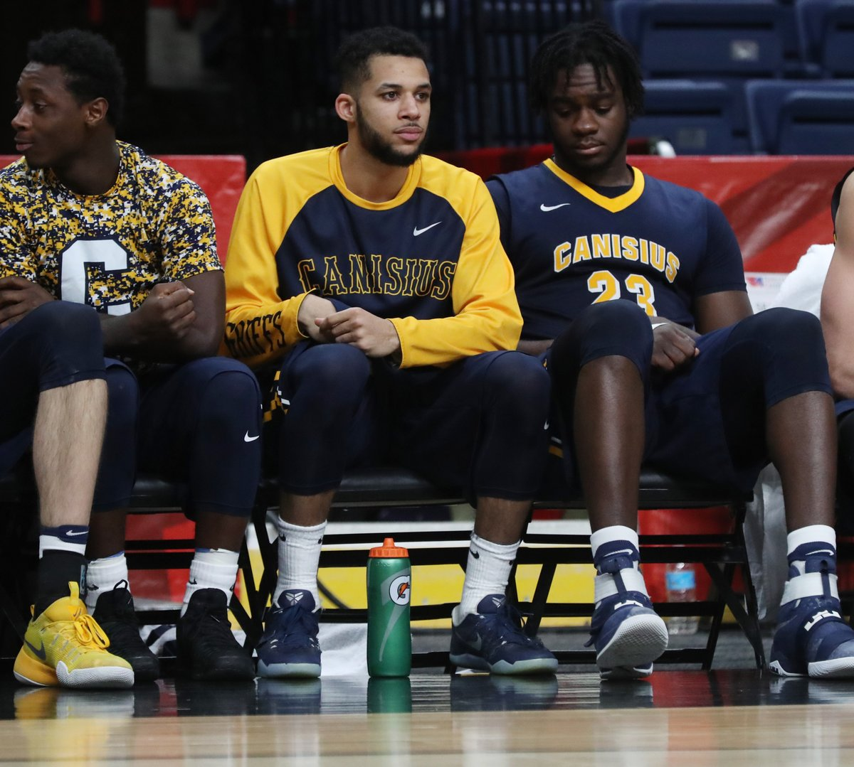 Canisius' Kassius Robertson sits on the bench during the second half of Friday's loss to St. Peter's. (James P. McCoy/Buffalo News)