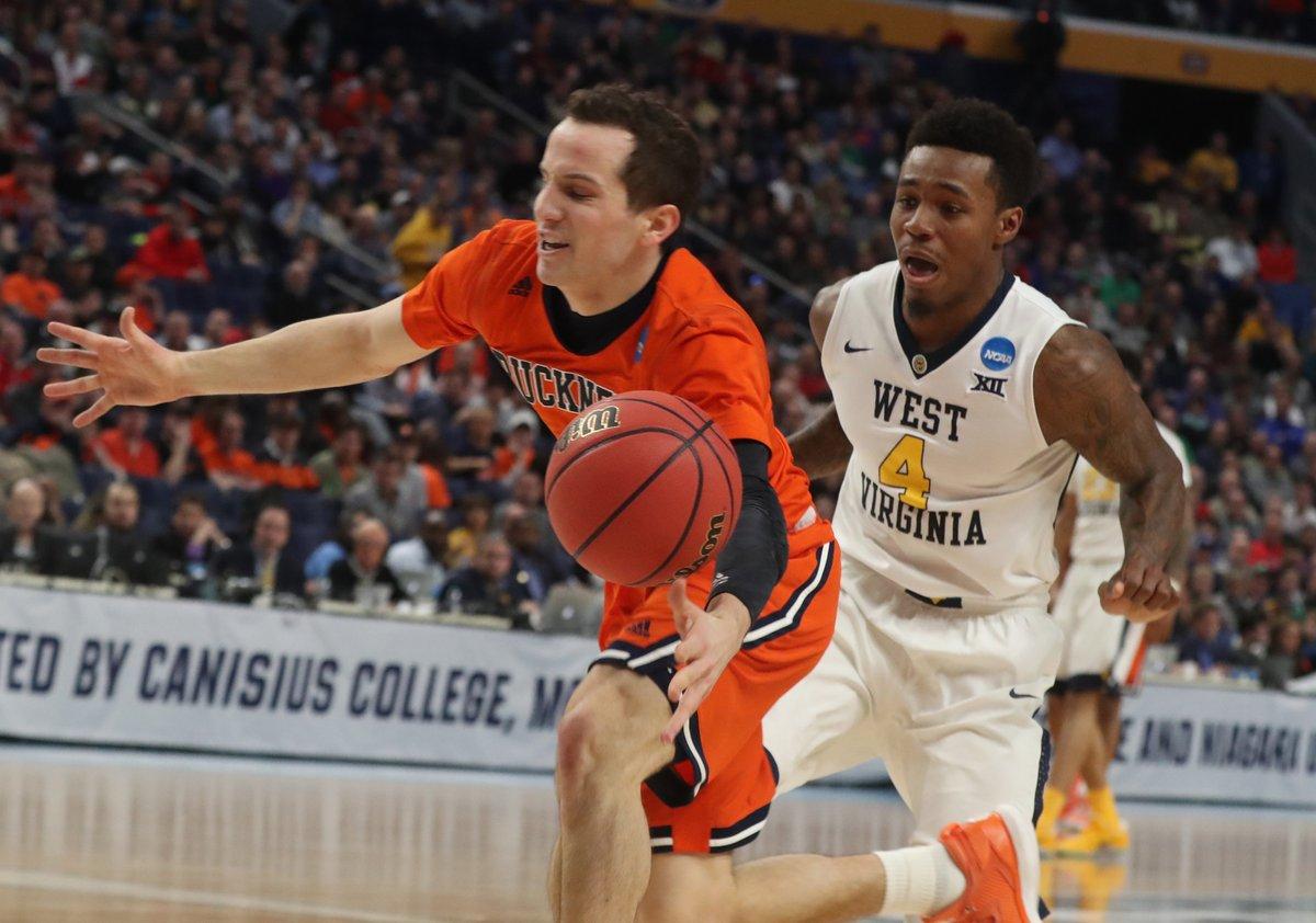 Bucknell's Kimball Mackenzie goes for a loose ball vs. West Virginia. (James P. McCoy/Buffalo News)