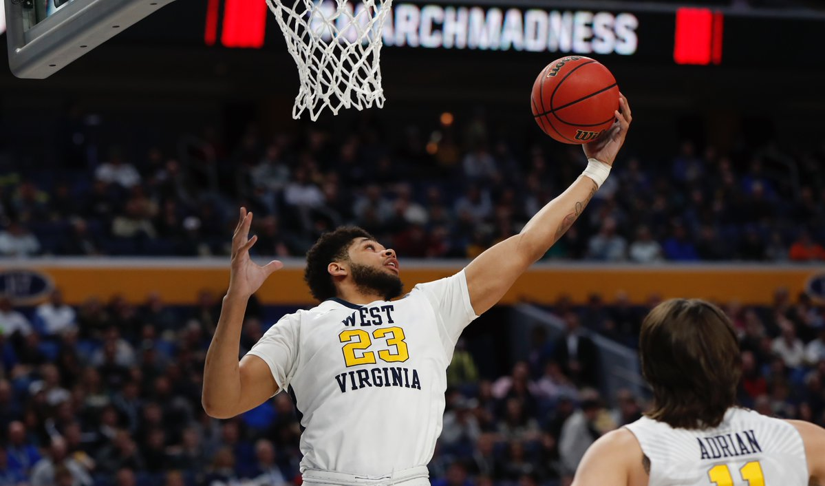 West Virginia's Esa Ahmed grabs a rebound. (Harry Scull Jr./Buffalo News)