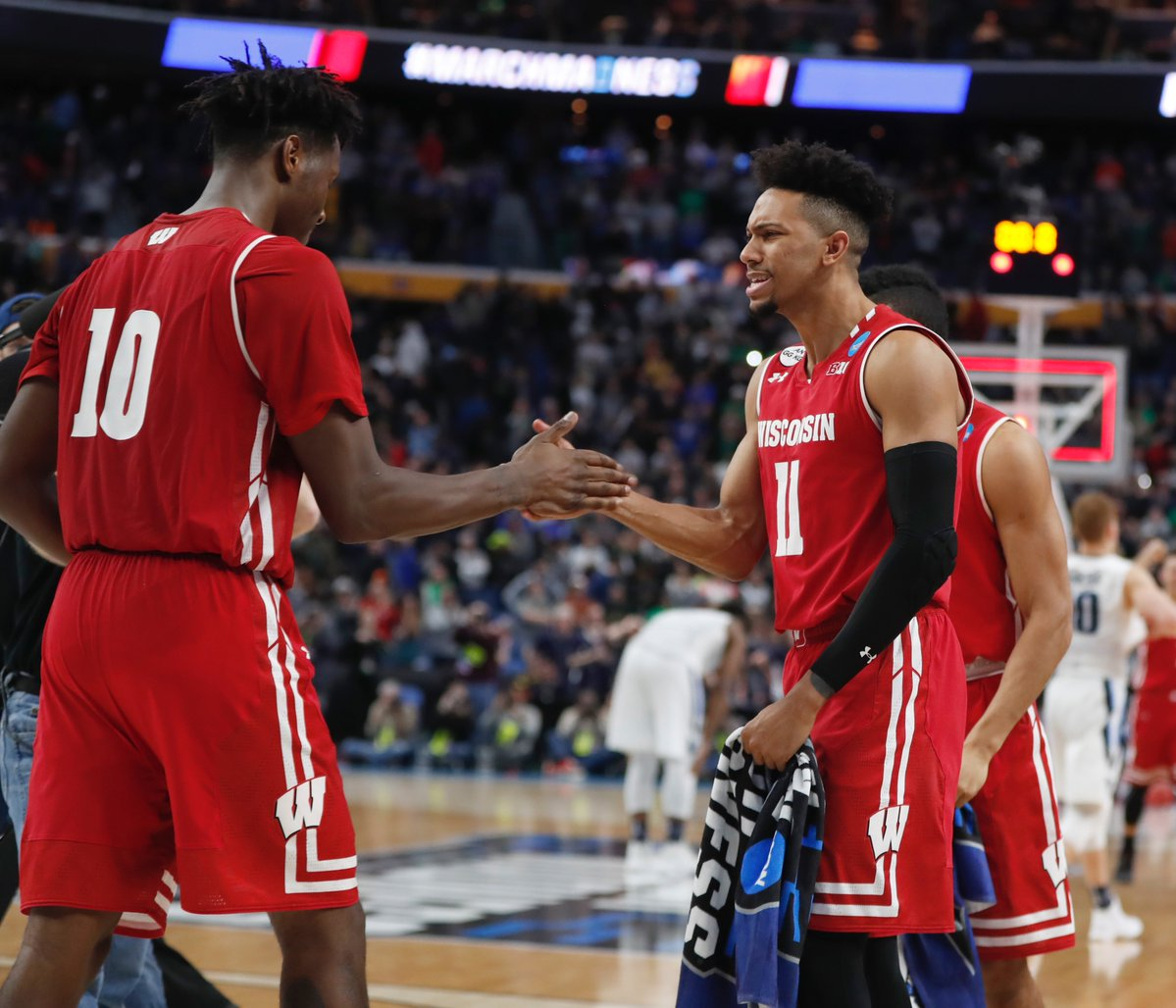 Wisconsin's Nigel Hayes (10) and Jordan Hill celebrate their victory over Villanova in the second round of the NCAA Tournament. (Harry Scull Jr./Buffalo News)