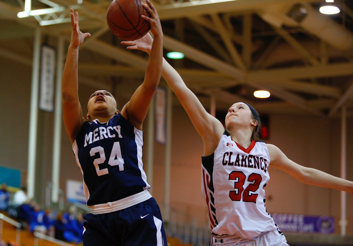 Traiva Breedlove of Mercyk battles Lauren Cullinan of Clarence in the AA game of the Far West Regionals. (Photo by Harry Scull Jr. / Buffalo News).