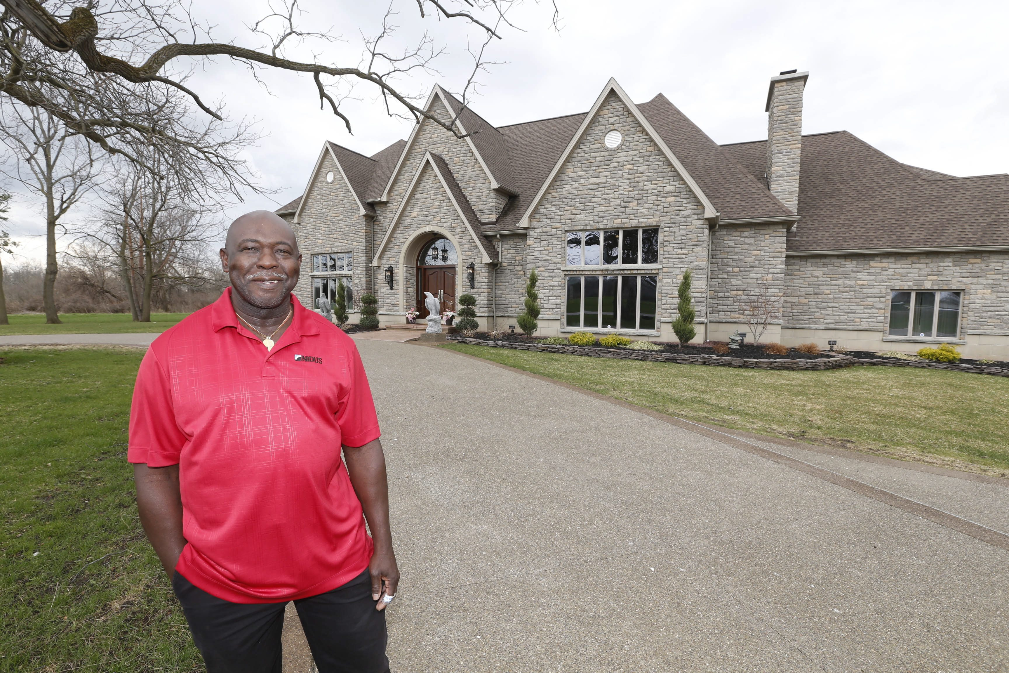 Dr. Greg Daniel with his geothermal mansion in Clarence. He has proposed building a subdivision with 51 upscale homes next to his home and horse farm. (Robert Kirkham/Buffalo News)