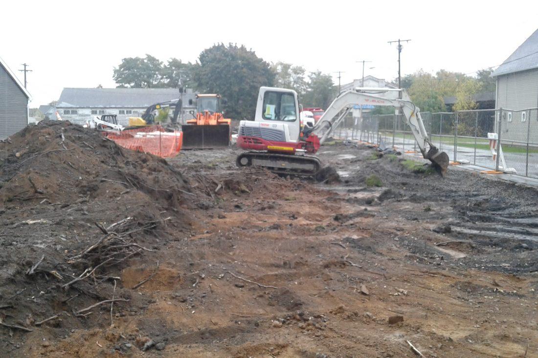 A DEC backhoe excavates soil on Vernon Street in Middleport on Oct. 27, 2016. (Thomas J. Prohaska/Buffalo News)