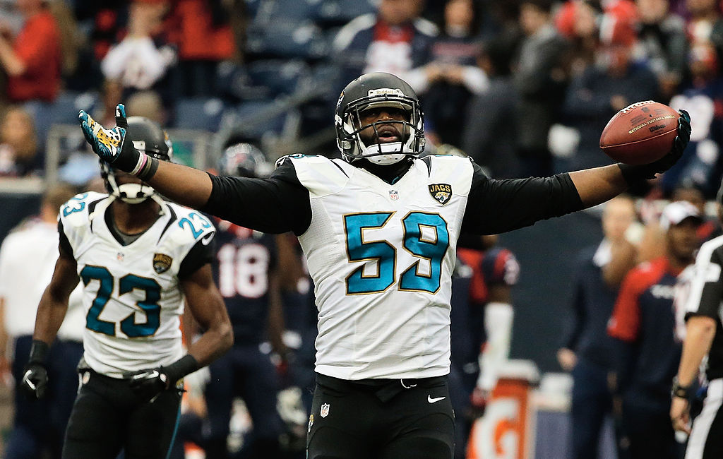 Ryan Davis #59 of the Jacksonville Jaguars celebrates after intercepting a pass late in the fourth quarter of the game against the Houston Texans at Reliant Stadium on November 24, 2013 in Houston, Texas.  (Getty Images)