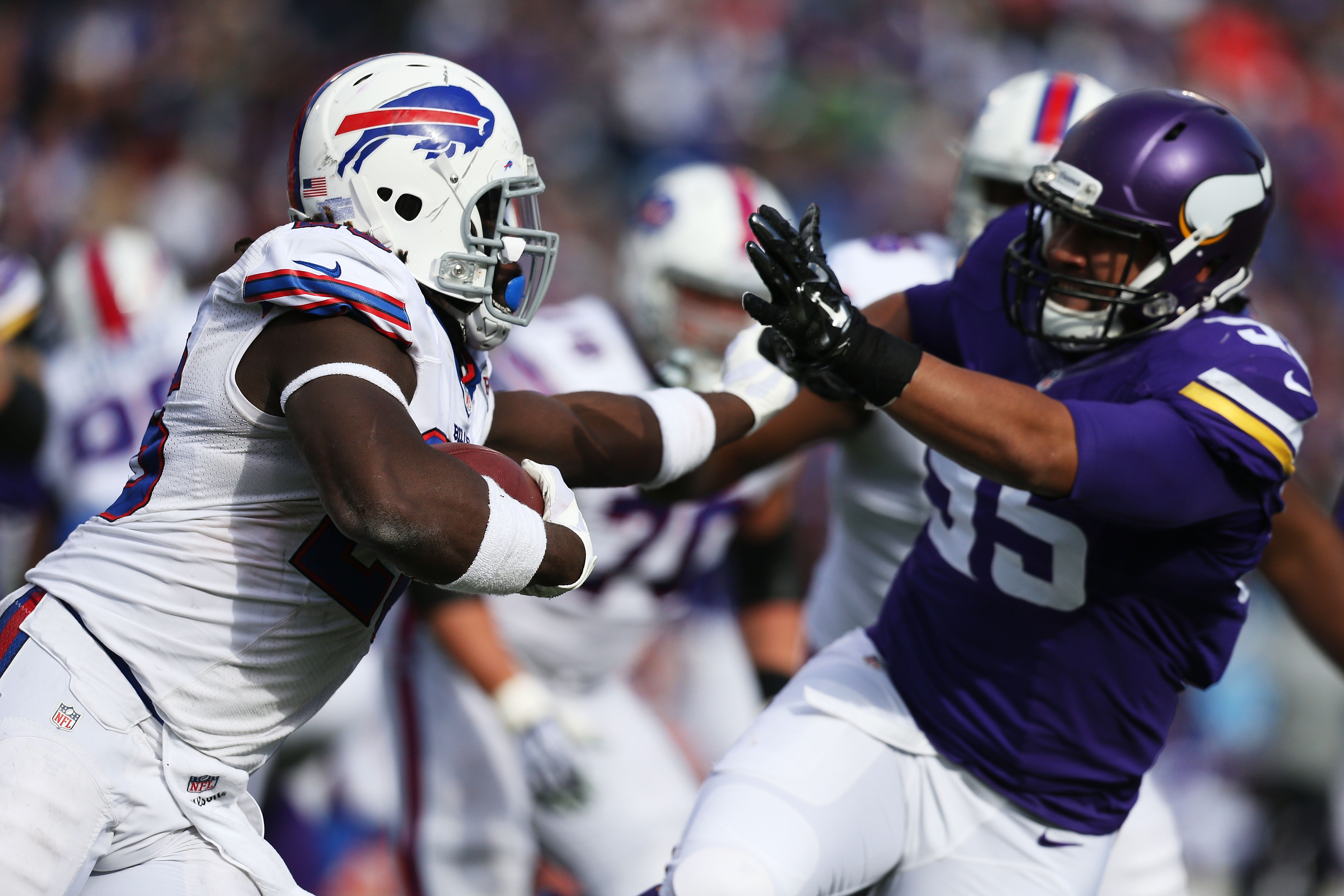 Former Vikings defensive end Scott Crichton, right, gets stiff-armed by former Bills running back Boobie Dixon in a game in 2014. (Photo by Brett Carlsen/Getty Images)