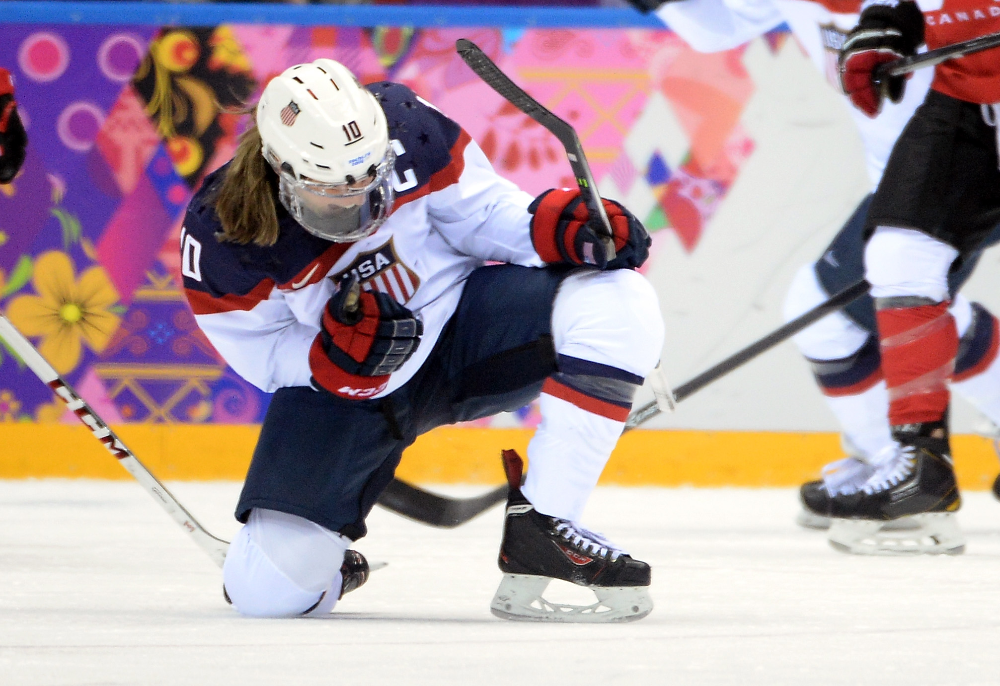 Meghan Duggan and her teammates are prepared to sit out the IIHF Women's World Championships in order to get an equitable deal from USA Hockey.  (Getty Images)