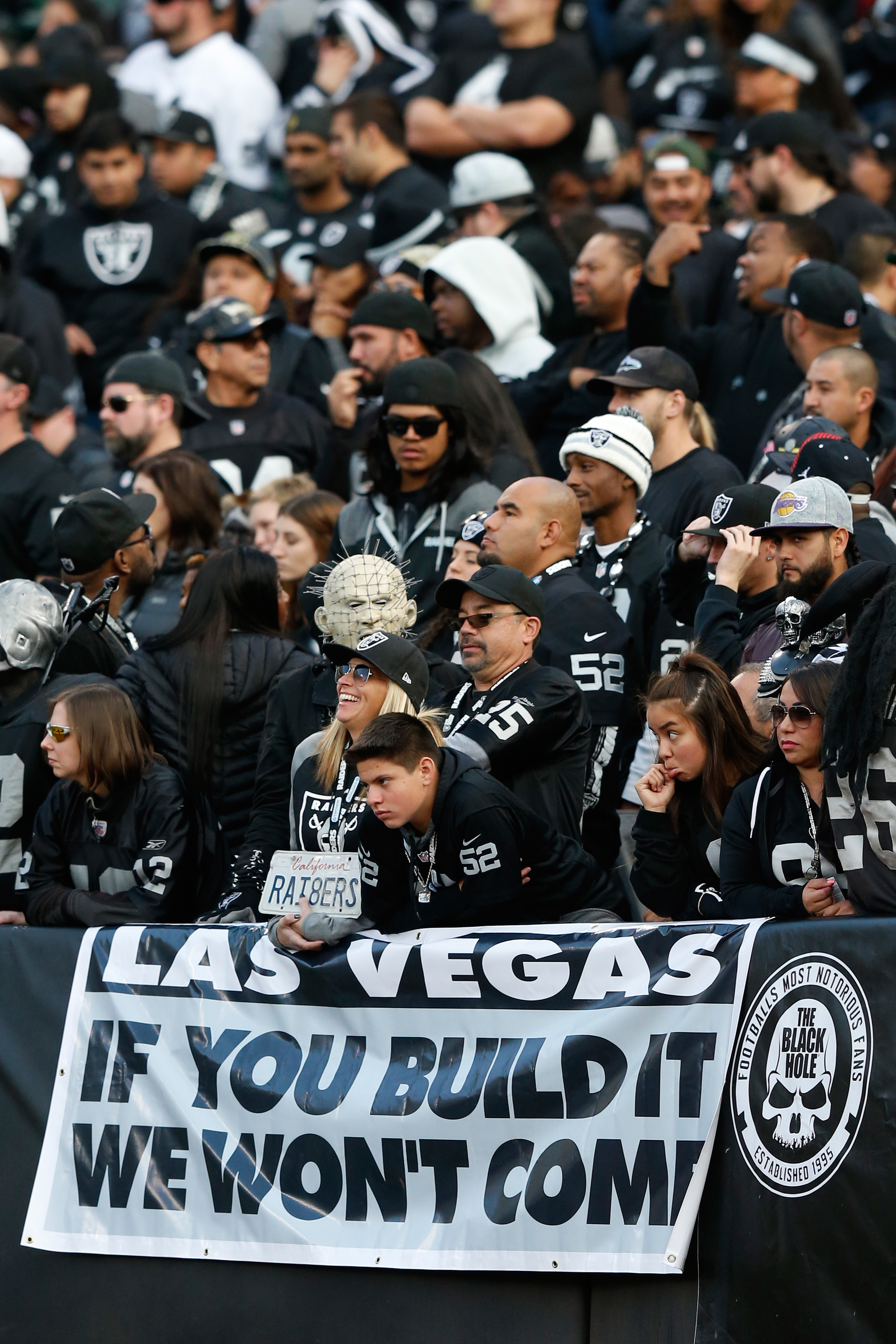 Oakland Raiders fans stand behind a sign referencing a potential move by the team to Las Vegas during their NFL game against the Carolina Panthers on November 27, 2016 in Oakland, California.  (Photo by Lachlan Cunningham/Getty Images)