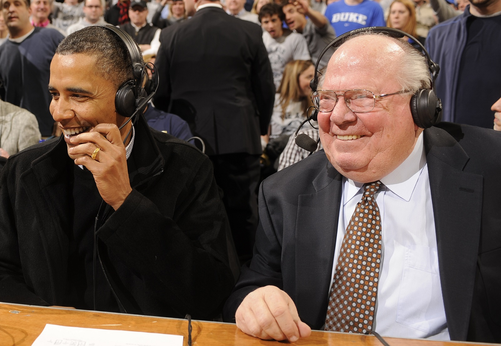 CBS commentator Verne Lindquist, right, seated with then-President Barack Obama, chats with The News about his Aaron Craft anecdote and the legendary Laettner call. (Getty Images)