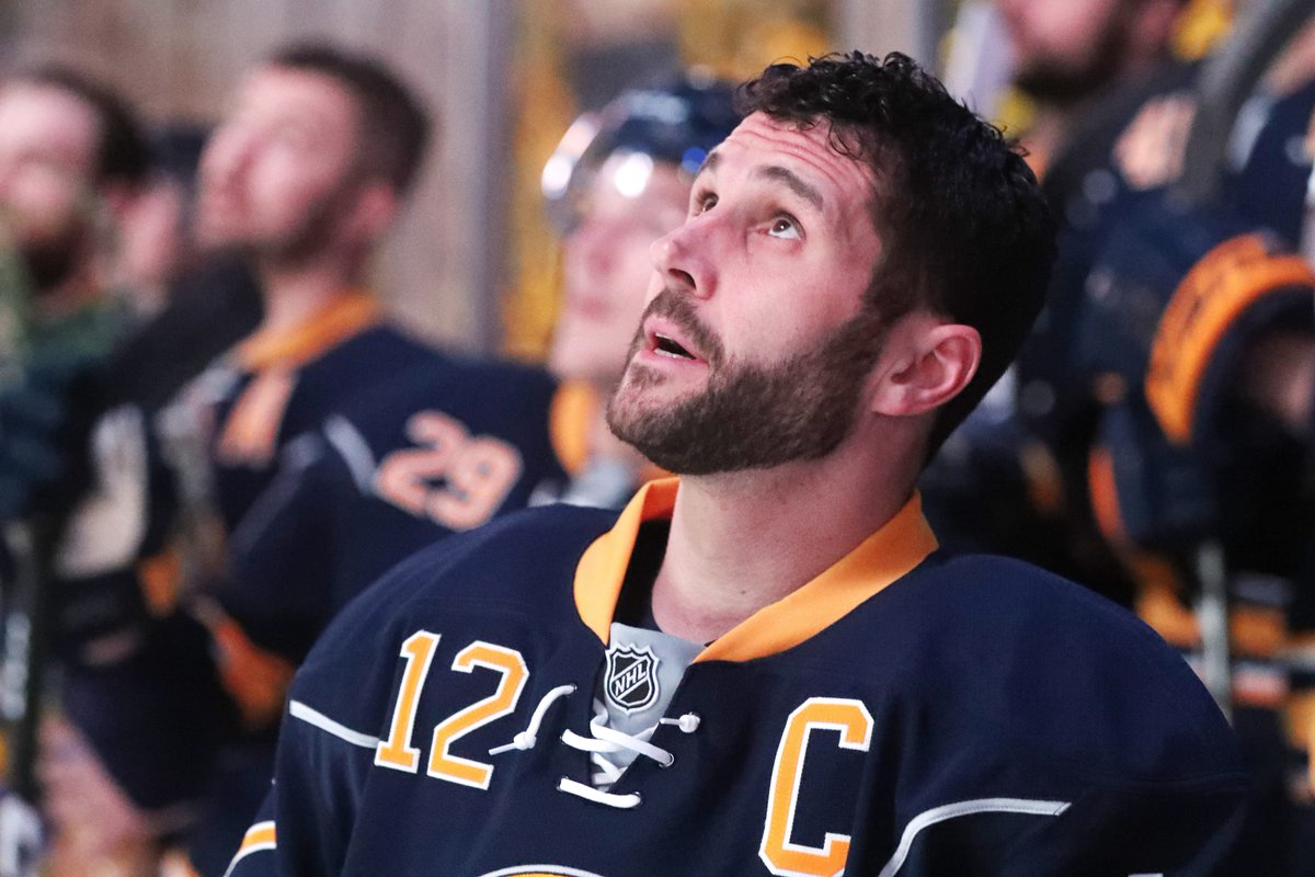 Brian Gionta and his teammates watch the pregame video honoring his 1,000th NHL game (James P. McCoy/Buffalo News).