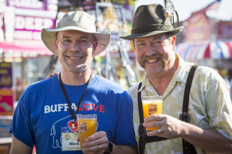 2016 Erie County Fair Beer Winner Mark Zambron shares a toast Flying Bison Brewery's Tim Herzog. (Courtesy Erie County Fair)