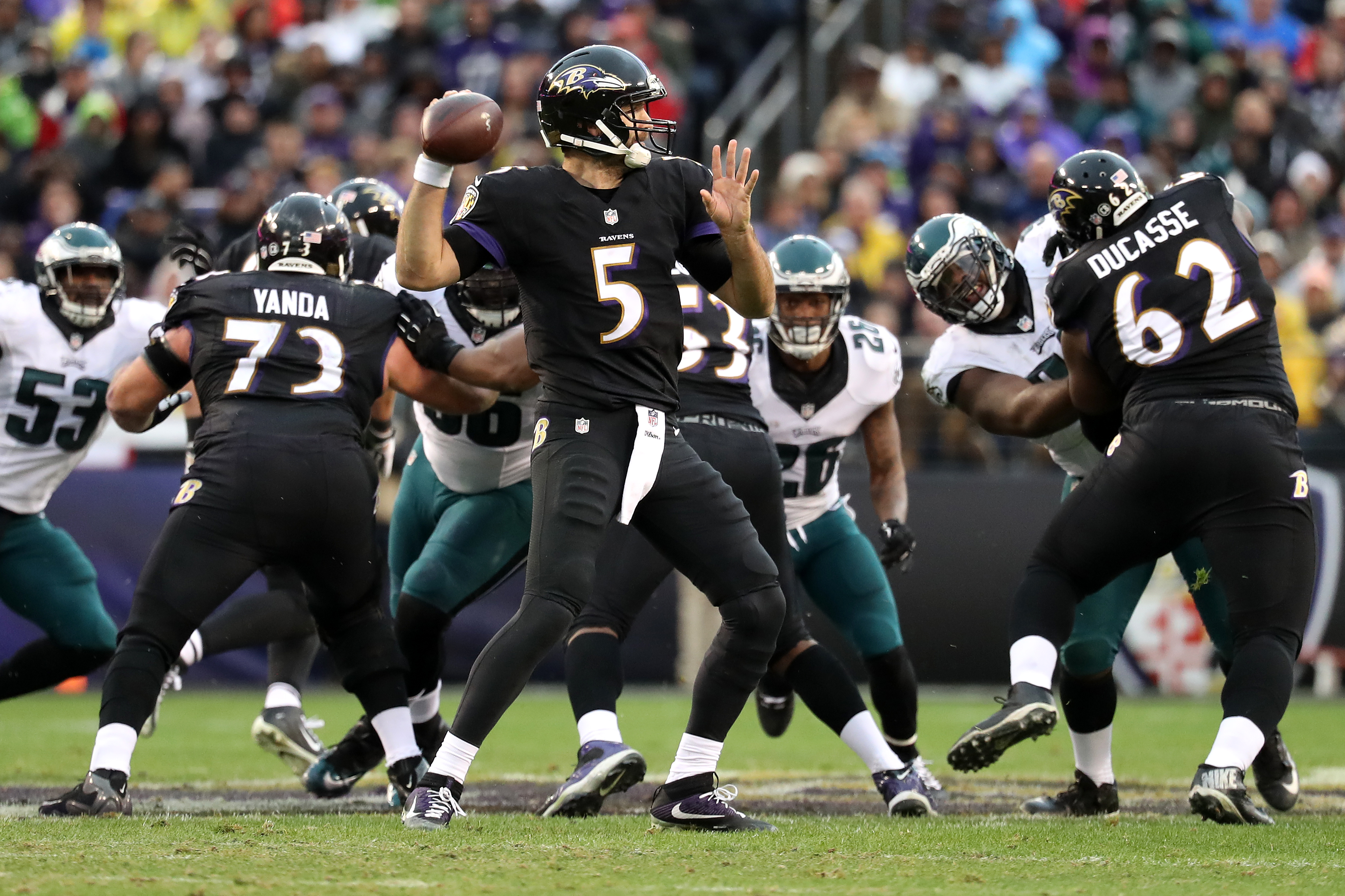 Quarterback Joe Flacco #5 of the Baltimore Ravens passes the ball while teammates guard Marshal Yanda #73 and offensive guard Vladimir Ducasse #62 block against the Philadelphia Eagles in the second quarter at M&T Bank Stadium on Dec. 18, 2016, in Baltimore, Md. (Getty Images)