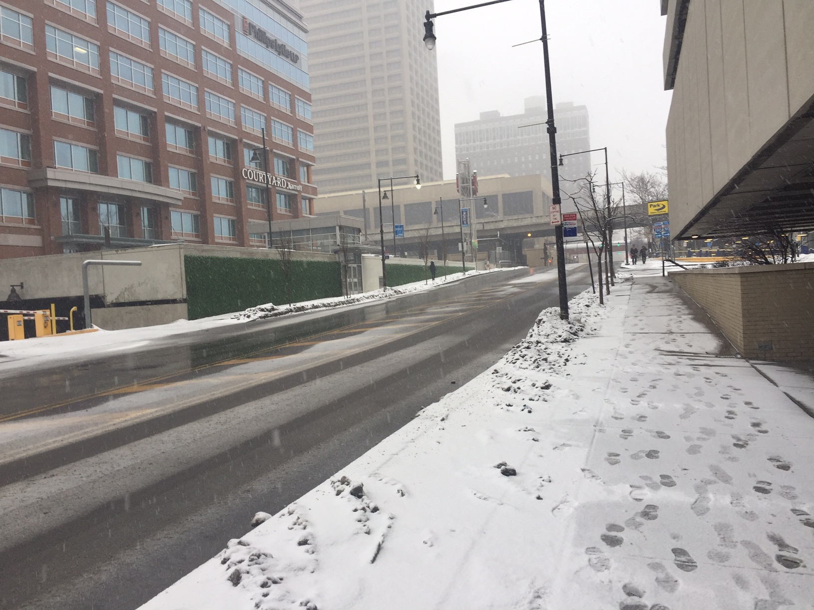 Light snow falling downtown Saturday morning. (Jean Westmoore/Buffalo News)