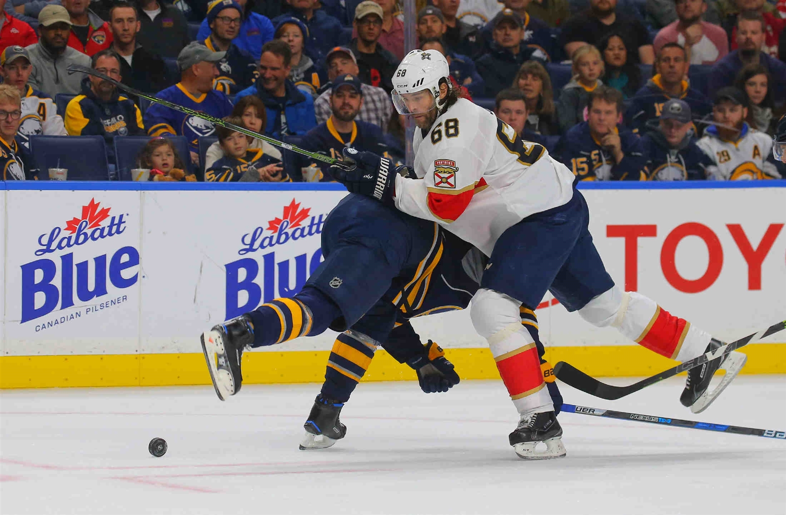 Jaromir Jagr battles Dmitry Kulikov during the Sabres' 3-0 win over the Panthers on Oct. 29 (John Hickey/Buffalo News).