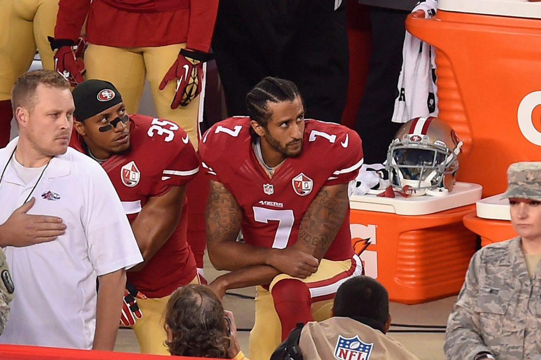 Quarterback Colin Kaepernick kneels during national anthem in 2016.