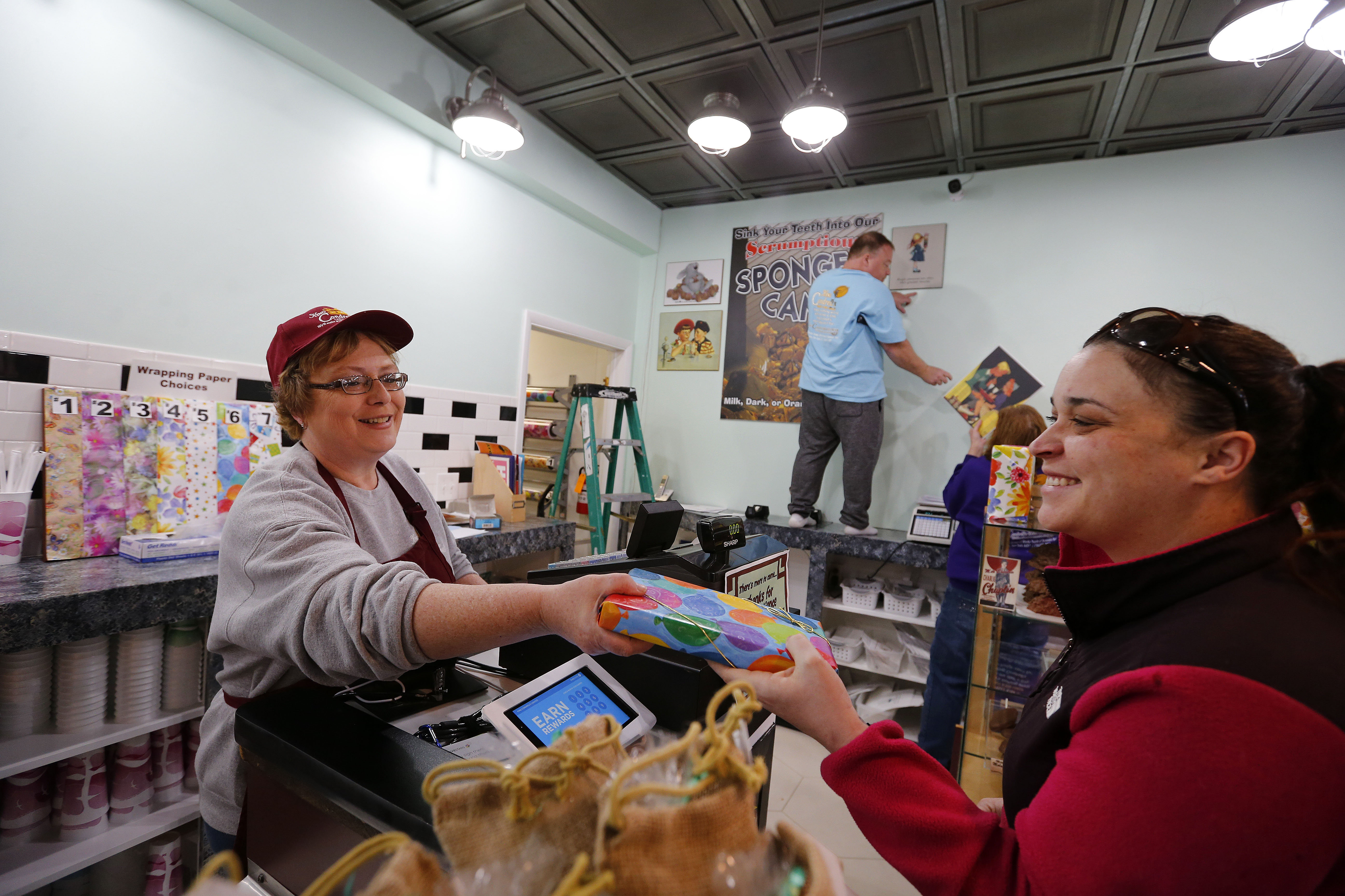 Tracy Peterson, left, helps customer Kailey Gyorffy, right, with a candy purchase at King Condrell's Candy & Ice Cream in Kenmore Thursday, March 2, 2017.        (Mark Mulville/Buffalo News)