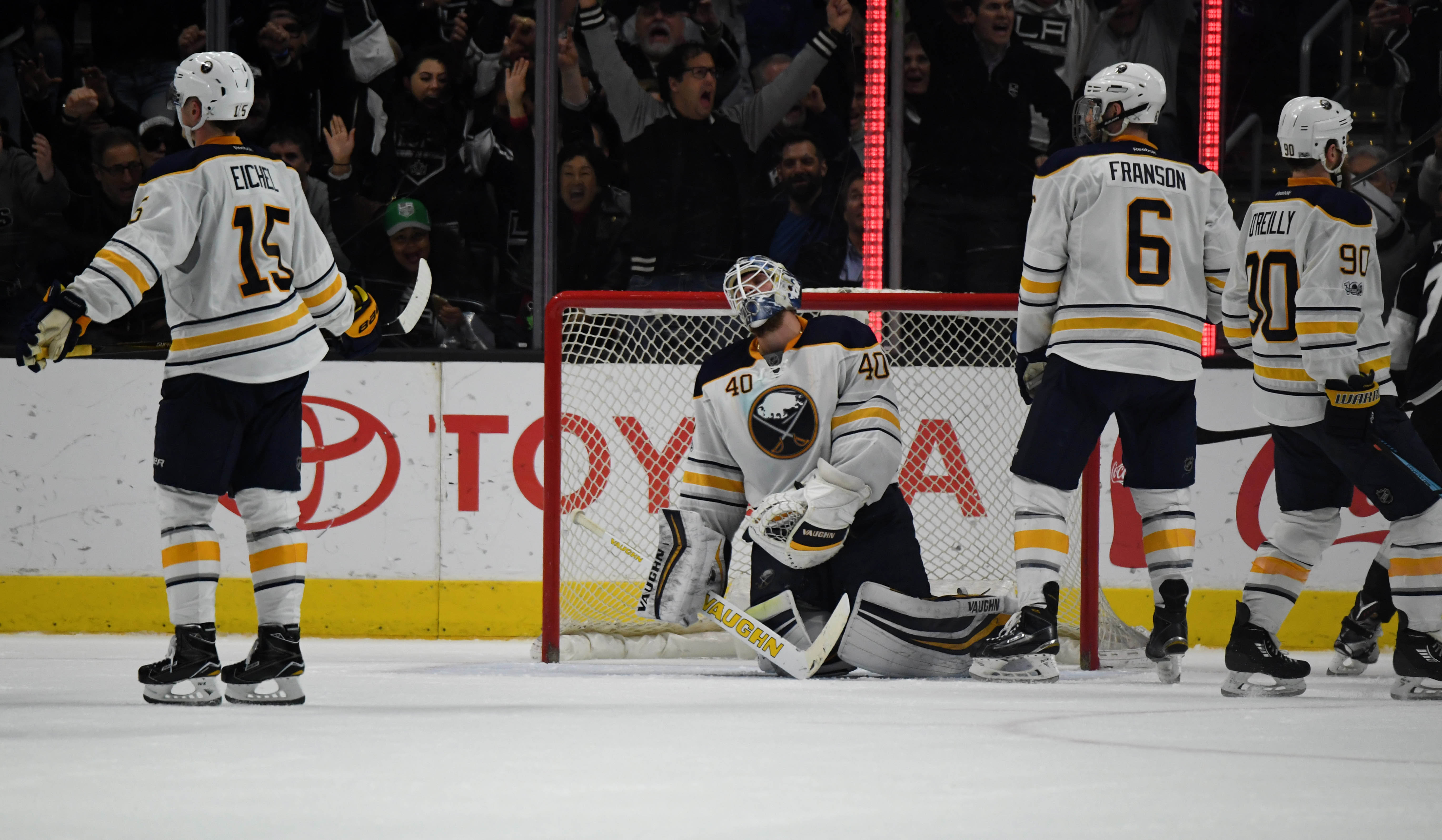 Jack Eichel (15), Cody Franson (6) and Ryan O'Reilly can do nothing to help Robin Lehner on the Kings' second goal Thursday night (USA Today Sports).