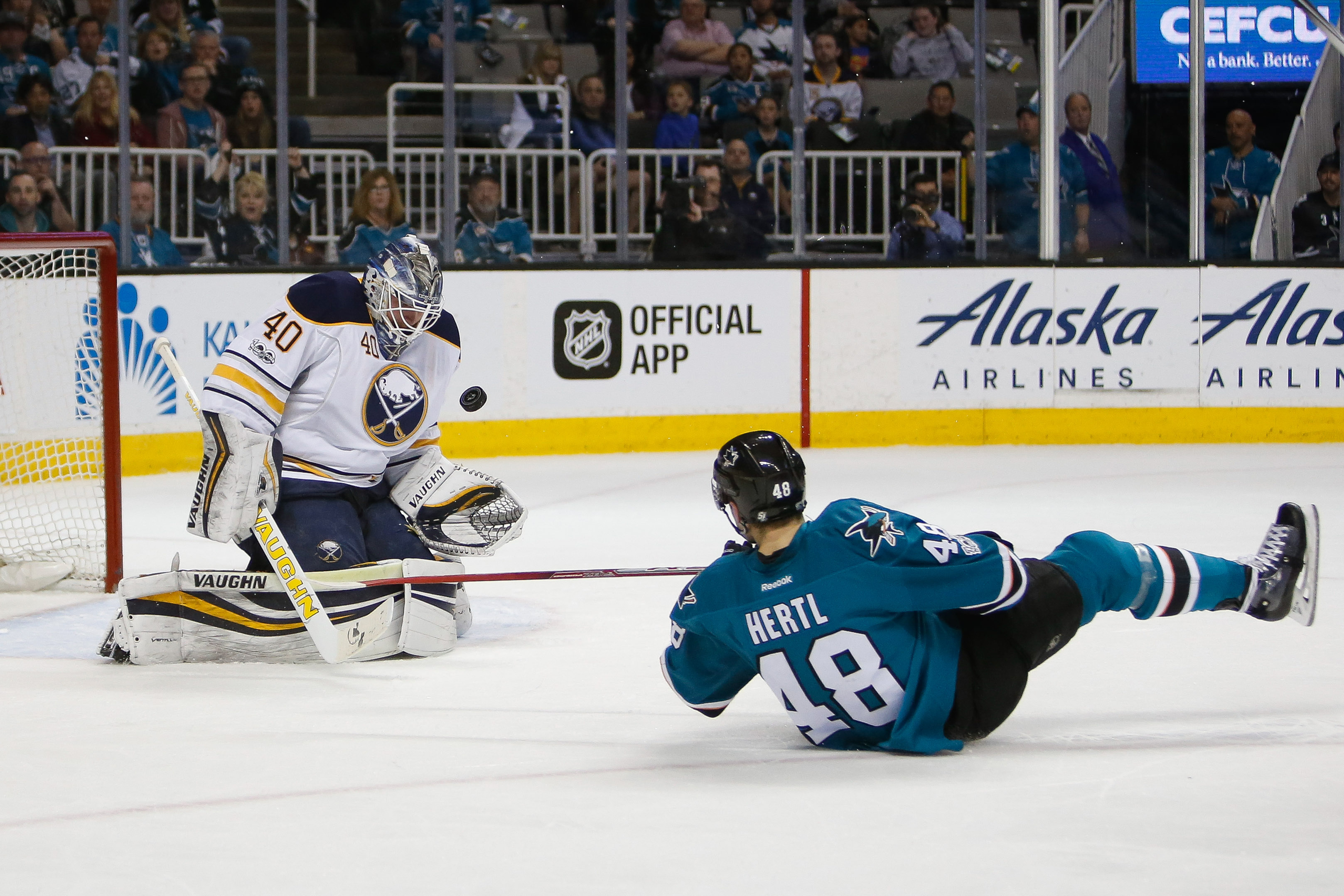 San Jose center Tomas Hertl slides toward the net after Sabres goalie Robin Lehner stopped him in first-period action Tuesday night (USA Today Sports).