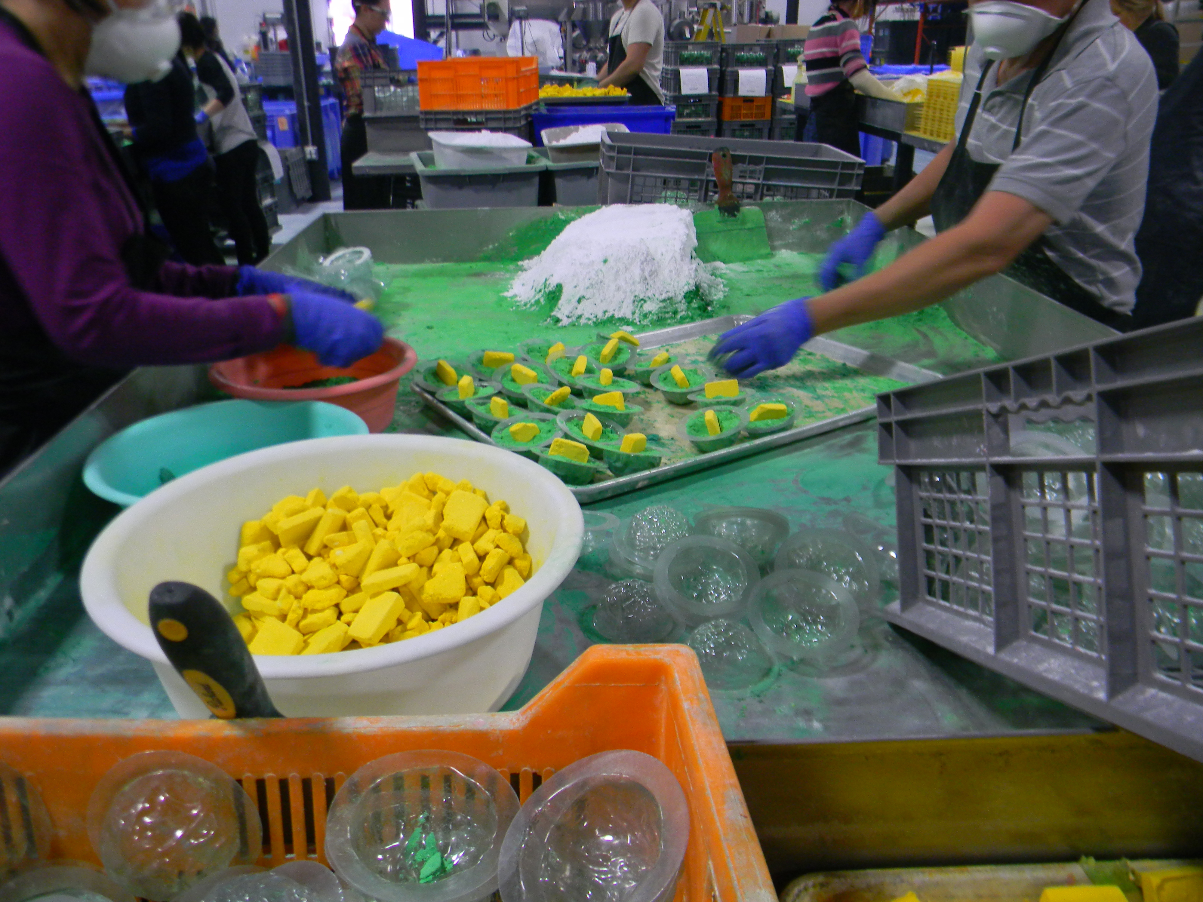 Workers assemble bath products in the Lush Cosmetics factory in Etobicoke, Ont.