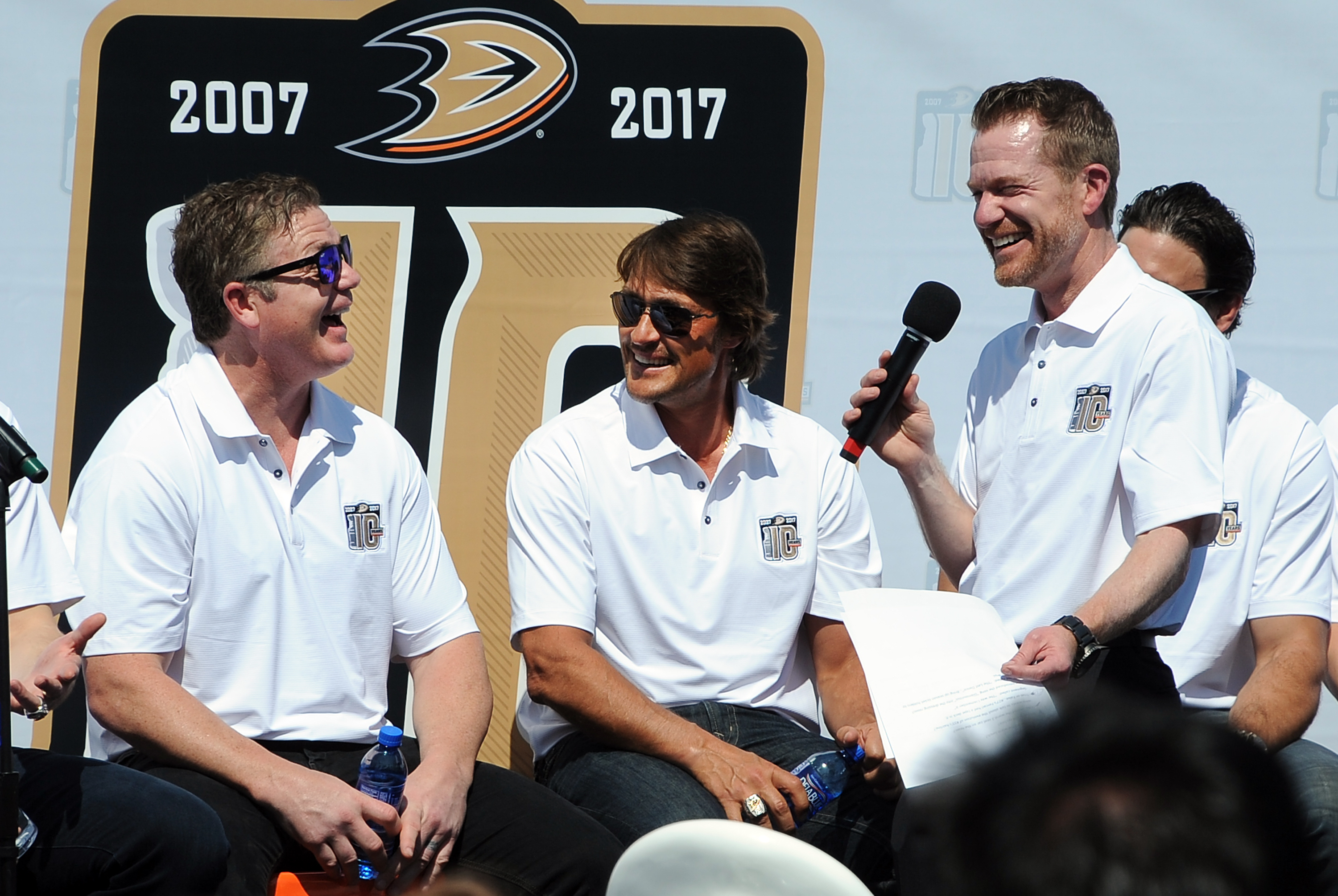 Brad May (left) answers a question from Ducks announcer Ken French as Teemu Selanne looks on during a fan Q&A session last week for the 2007 Stanley Cup champions (Photo courtesy Anaheim Ducks).