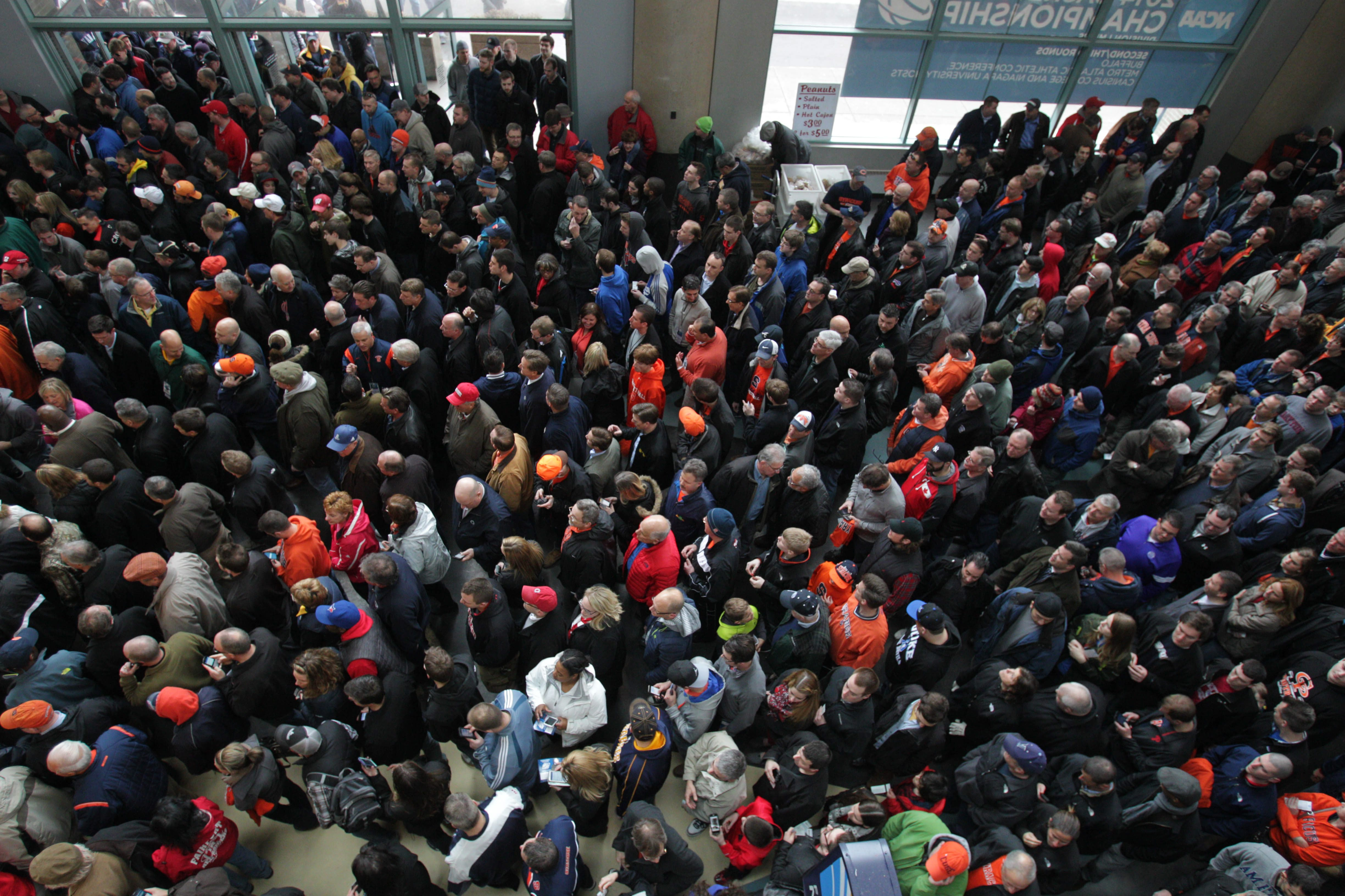 Fans jam into the lobby of KeyBank Arena, which was then known as First Niagara Center, for the NCAA tournament in 2014.  (Sharon Cantillon/Buffalo News)